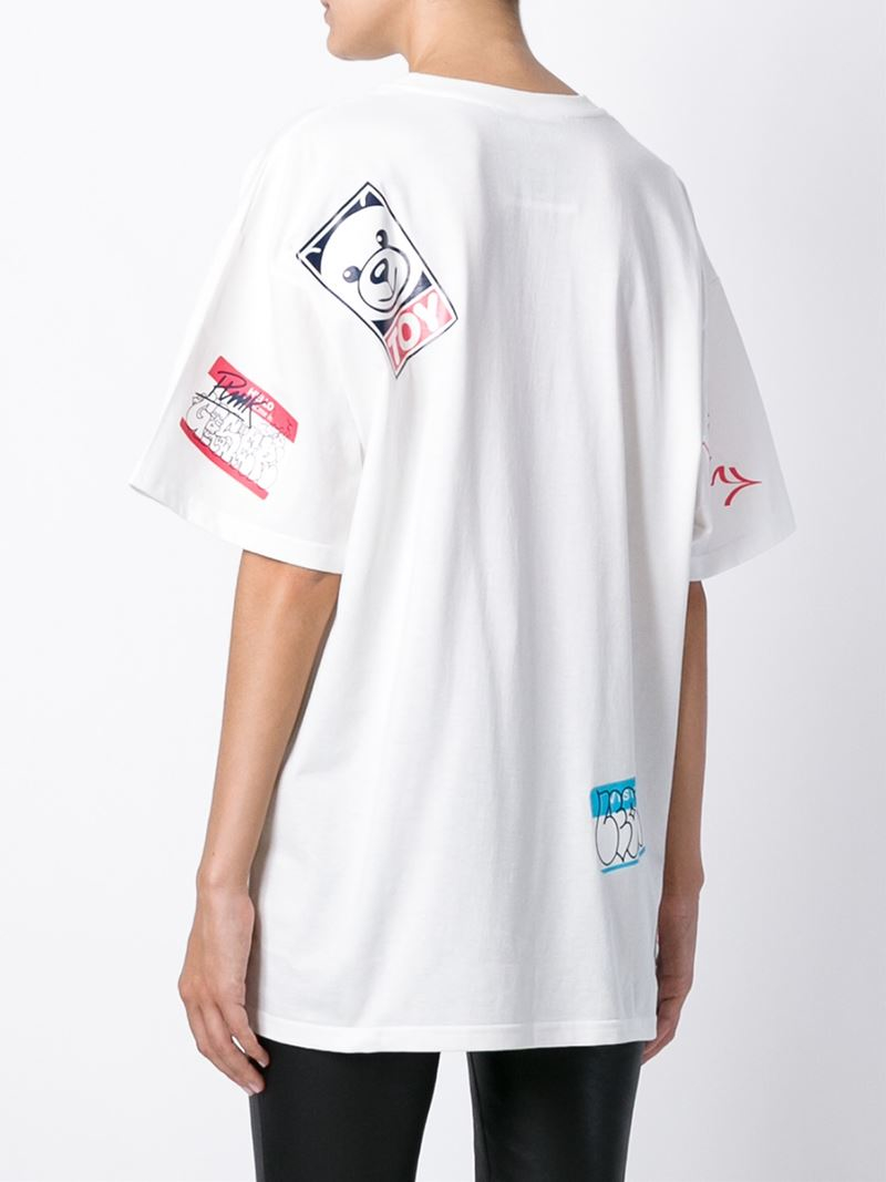 Moschino name tag print t shirt in white lyst for Print name on shirt