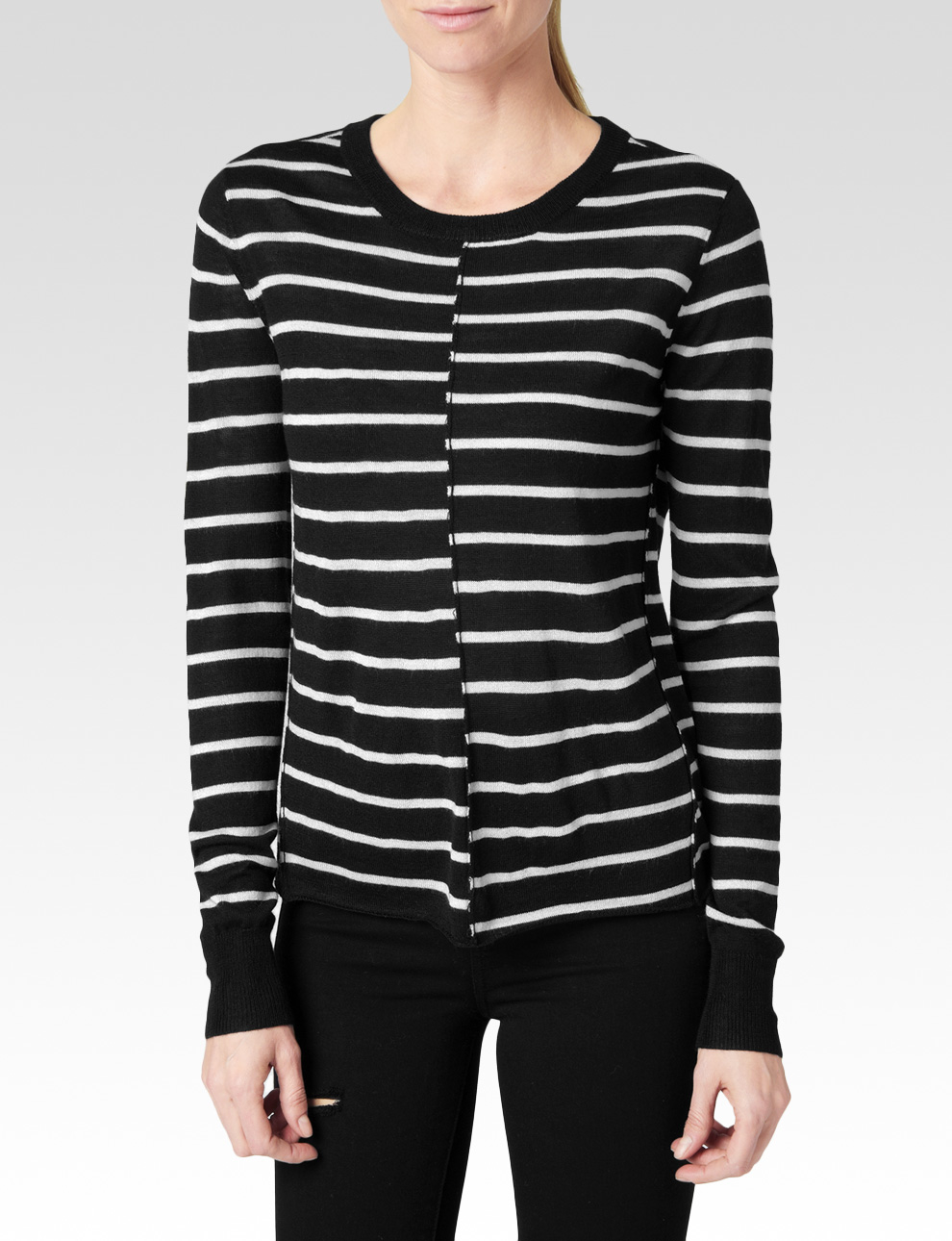 A black and white striped sweater is the perfect foundation piece to pair with solid black, solid white, or camel. Pair your sweater with black leather leggings, high-heeled boots and a chic camel blazer or jacket for a fashionable daytime outfit.