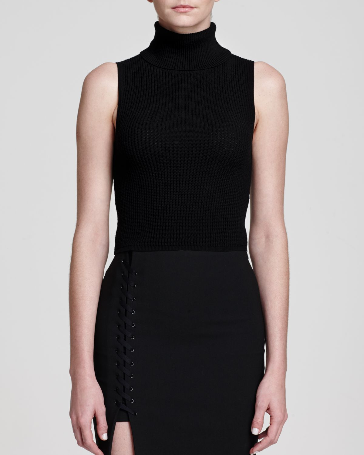 Elizabeth And James Sleeveless Turtleneck Sweater In Black