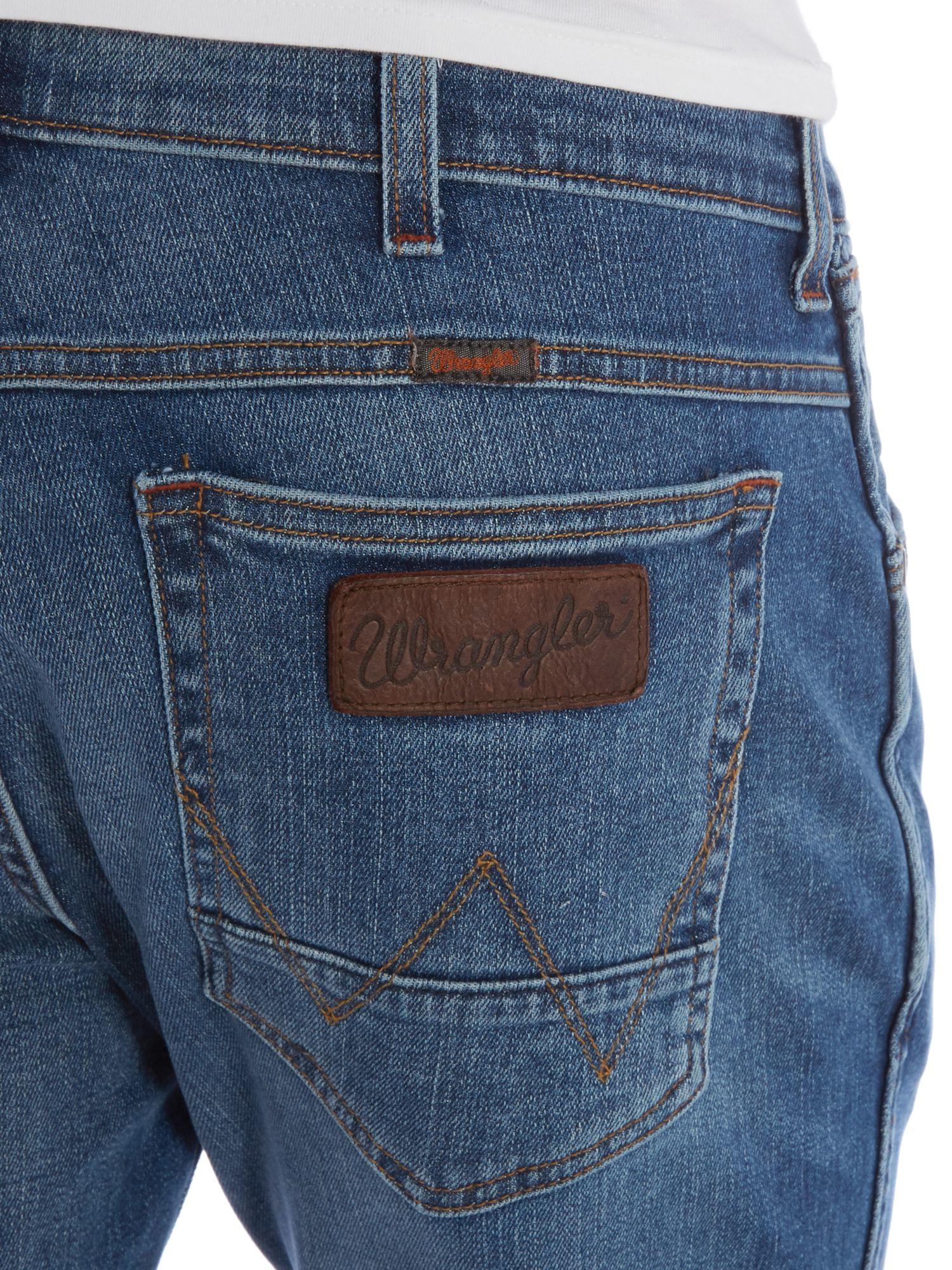 Wrangler greensboro from here straight leg jean in blue for Wrangler denim shirts uk