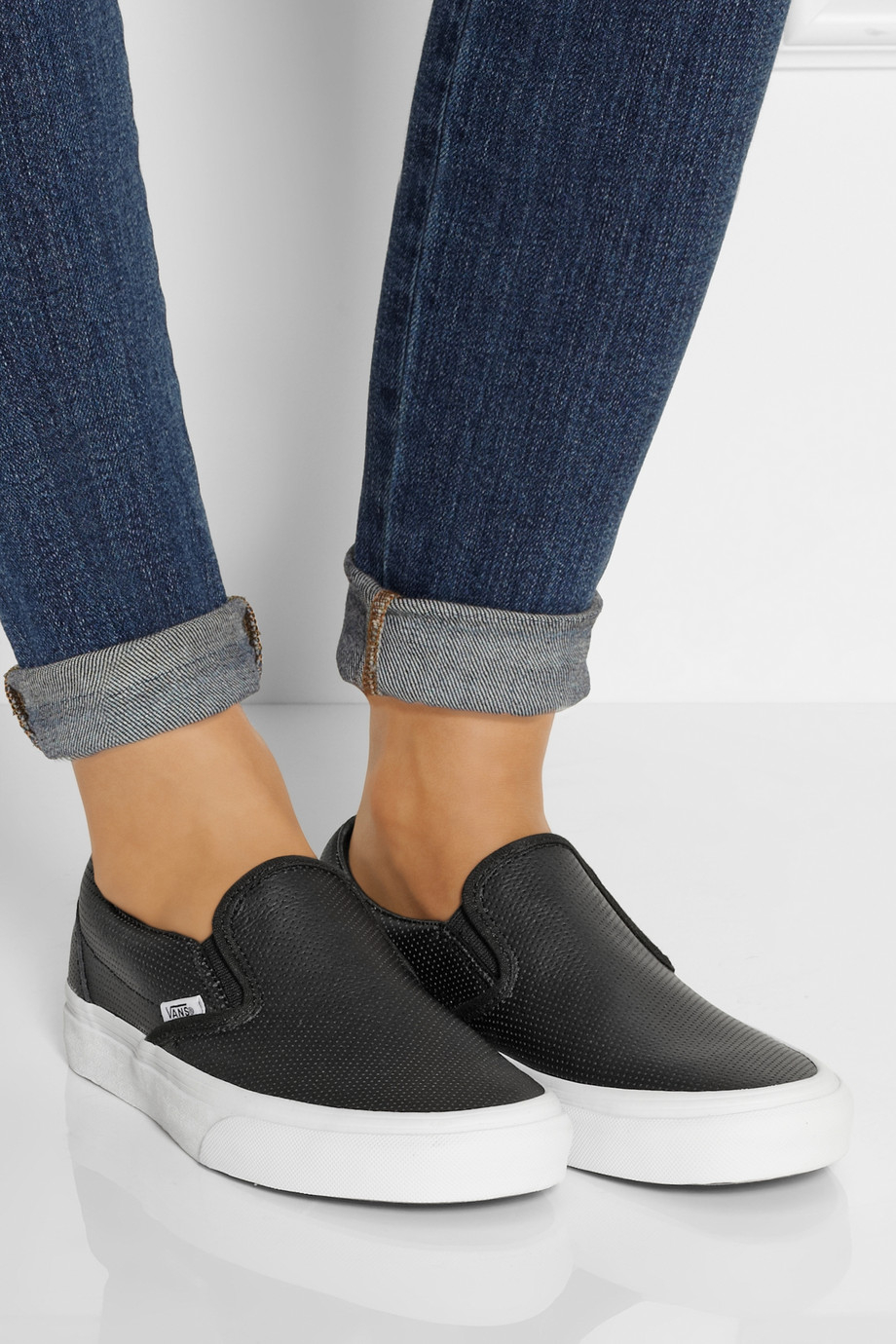 c6f85bb03e5 Lyst - Vans Perforated Leather Slip-On Sneakers in Black