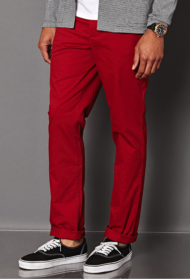 Bring the laidback look of men's chino pants to the office. Check out Polo Ralph Lauren flat front chinos made with vintage-looking woven cotton. Add a colorful punch to any outfit with brightly colored chinos.
