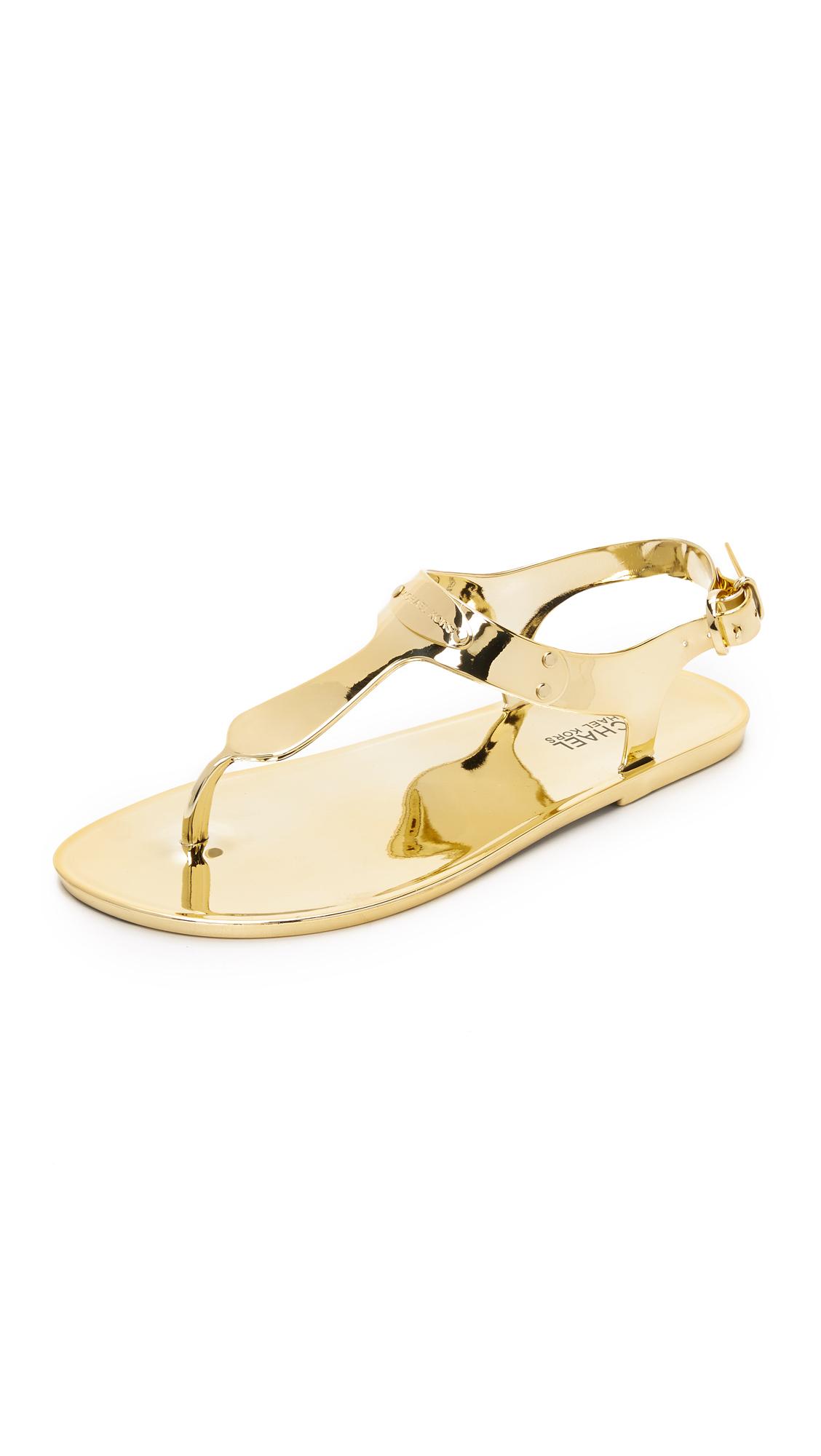 430d806e8cd5c9 Lyst - MICHAEL Michael Kors Mk Plate Jelly Sandals - Gold in Metallic