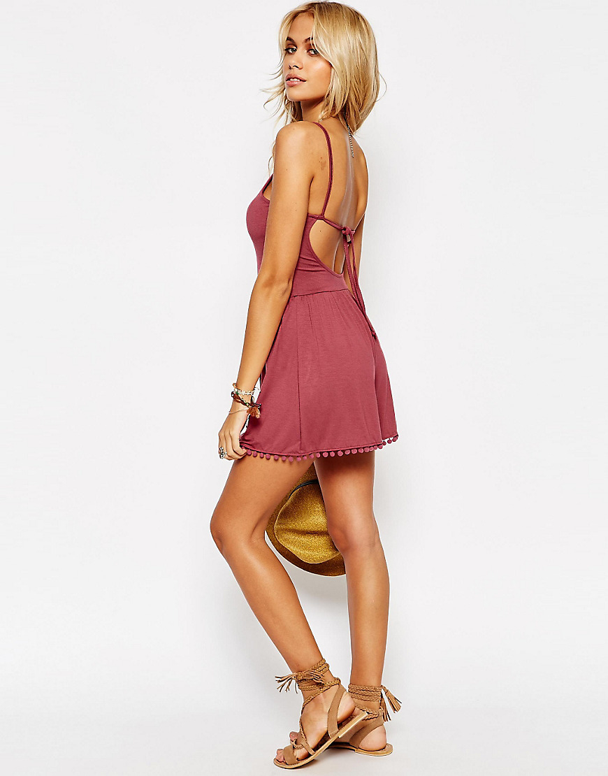 ac4ff60a87b Asos 90 s Strappy Playsuit With Tie Back And Pom Pom Hem in Pink - Lyst