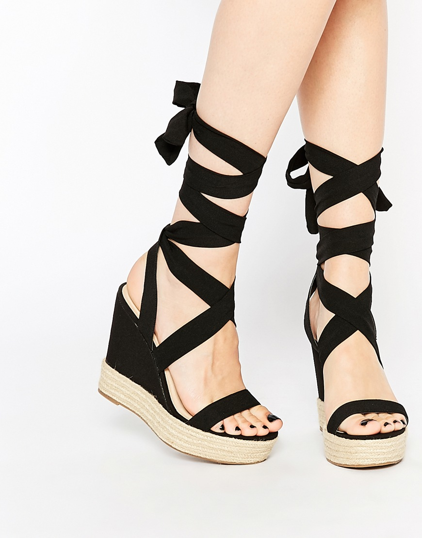 d97352bf650 Lyst - ASOS Tornado Lace Up Wedges in Black