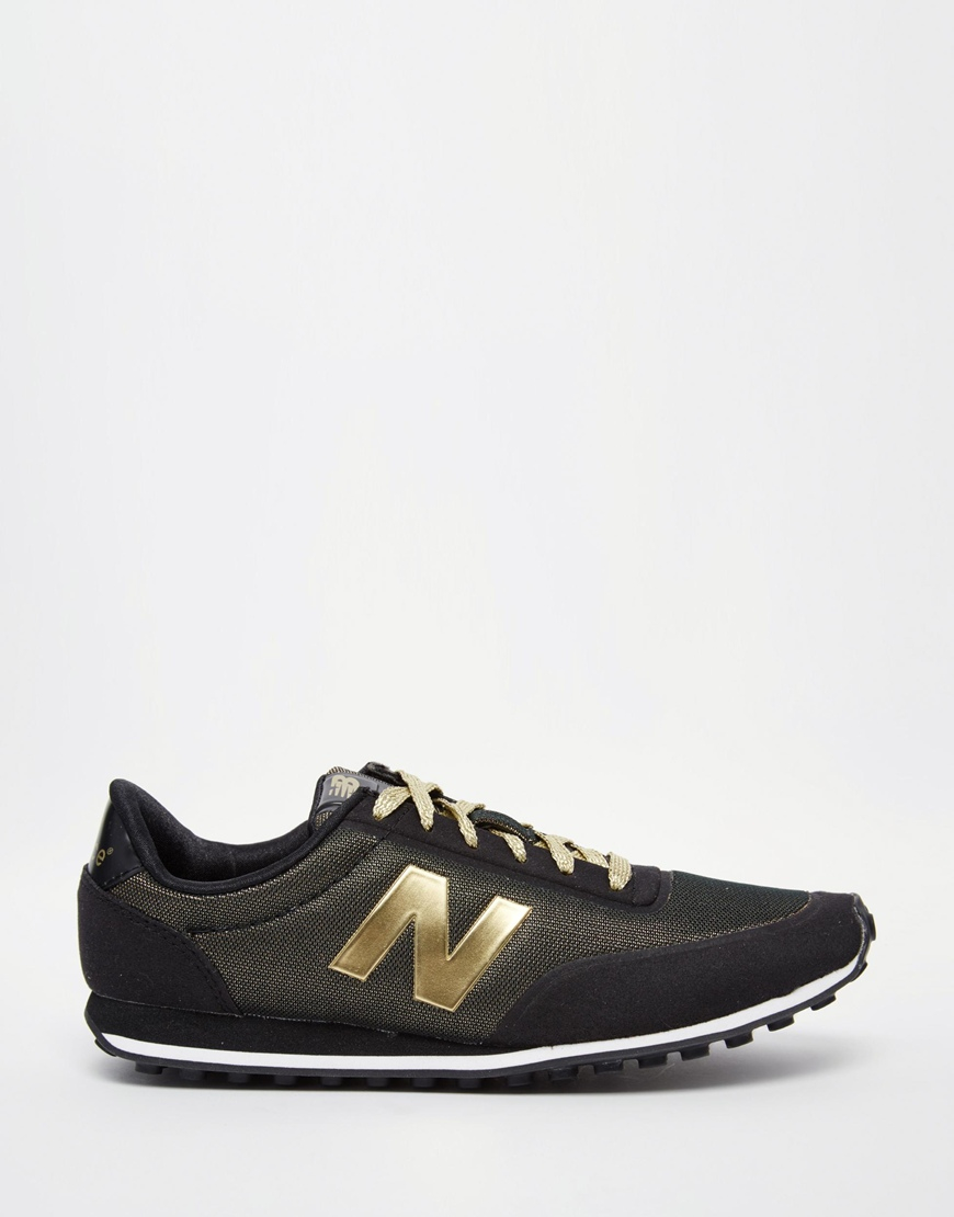 new balance 410 black metallic gold trainers in gold. Black Bedroom Furniture Sets. Home Design Ideas
