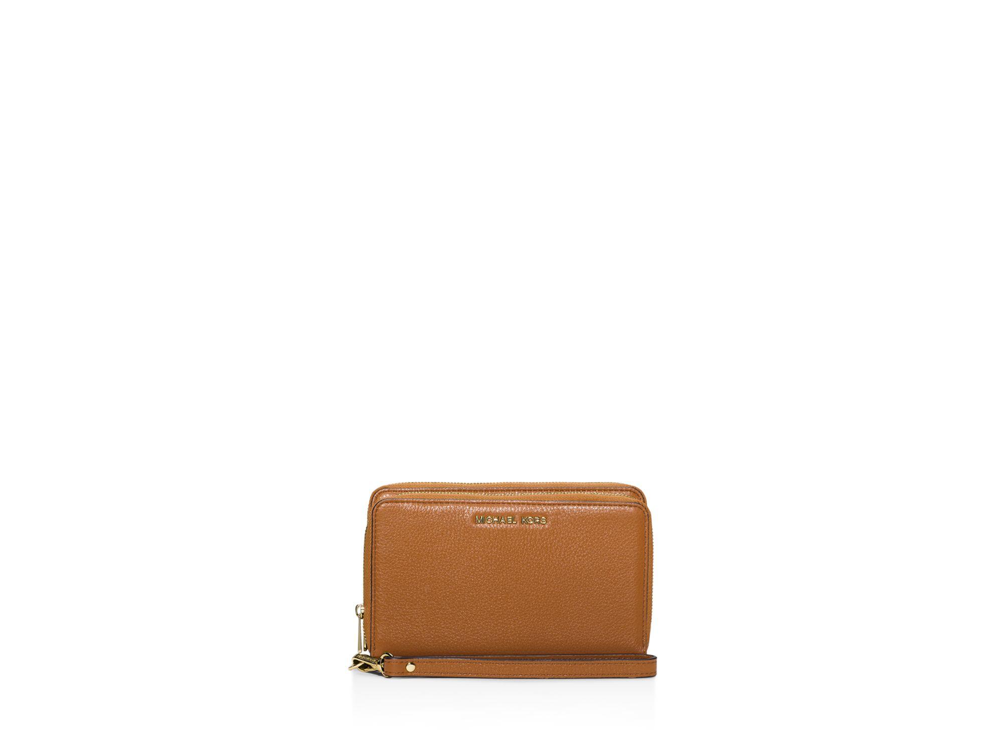 78f3808ea2b3 Lyst - MICHAEL Michael Kors Adele Large Flat Multifunction Wallet