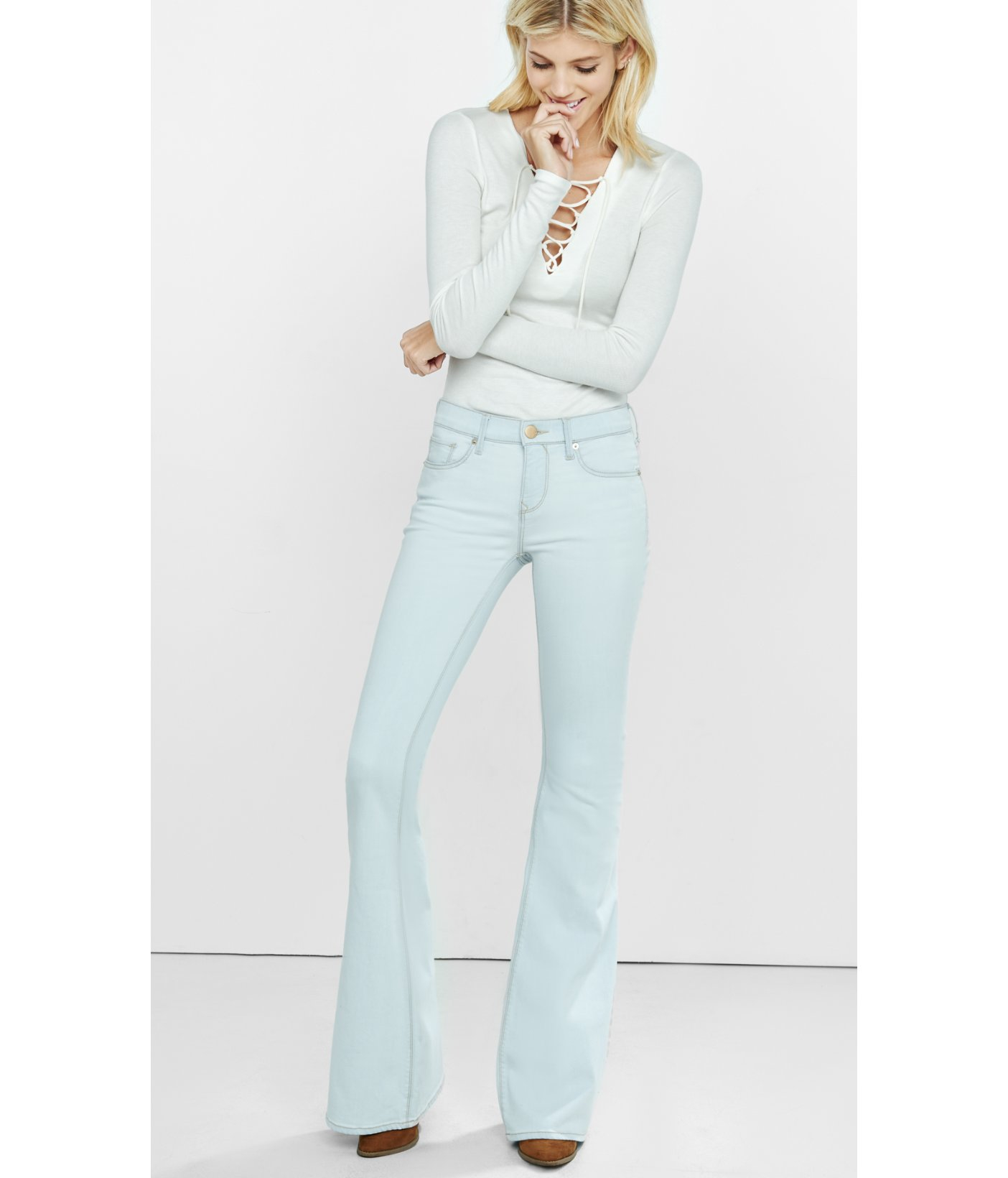 6986903354a Lyst - Express Light Wash Mid Rise Bell Flare Jeans in Blue