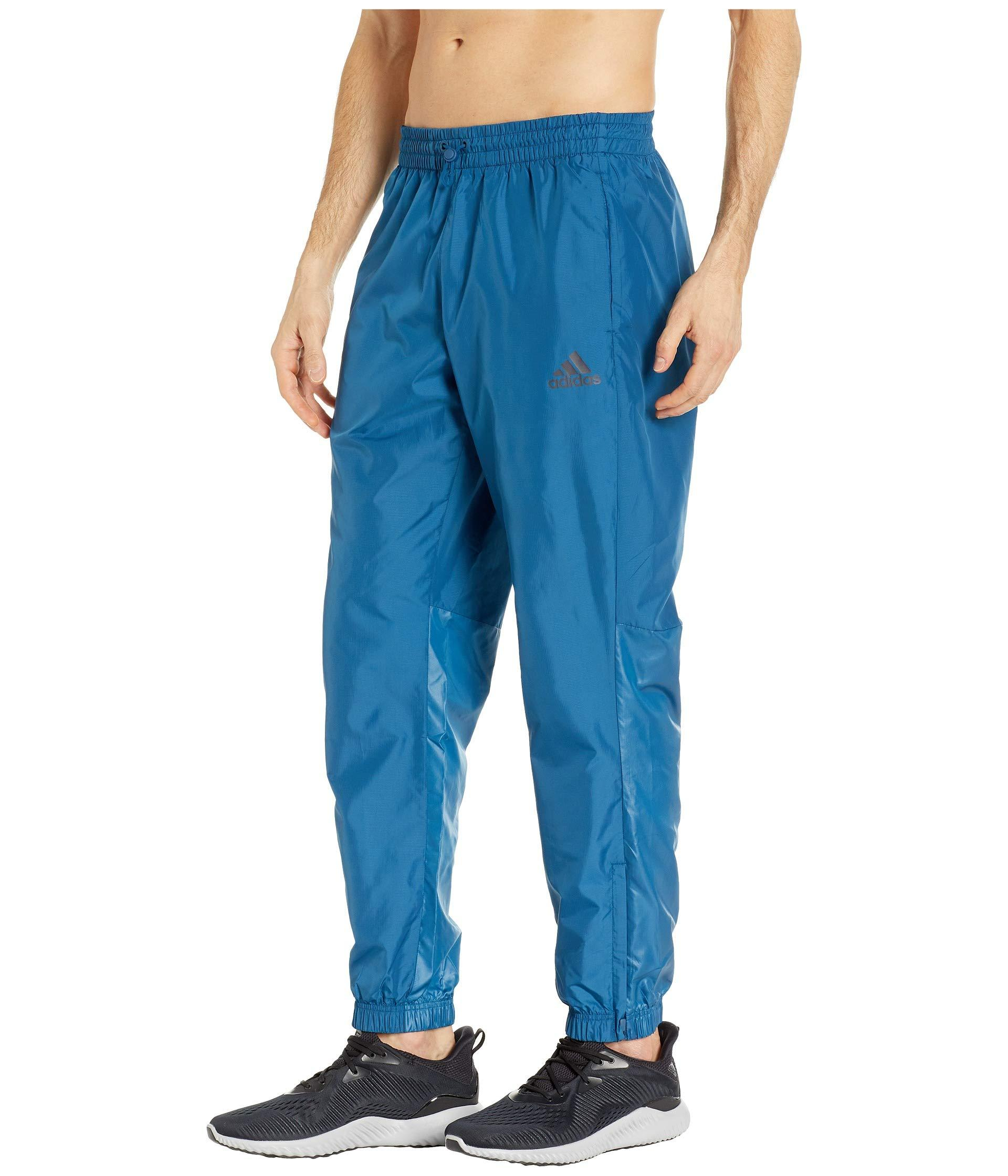 1a83b986172 Lyst - adidas Wind Pants in Blue for Men