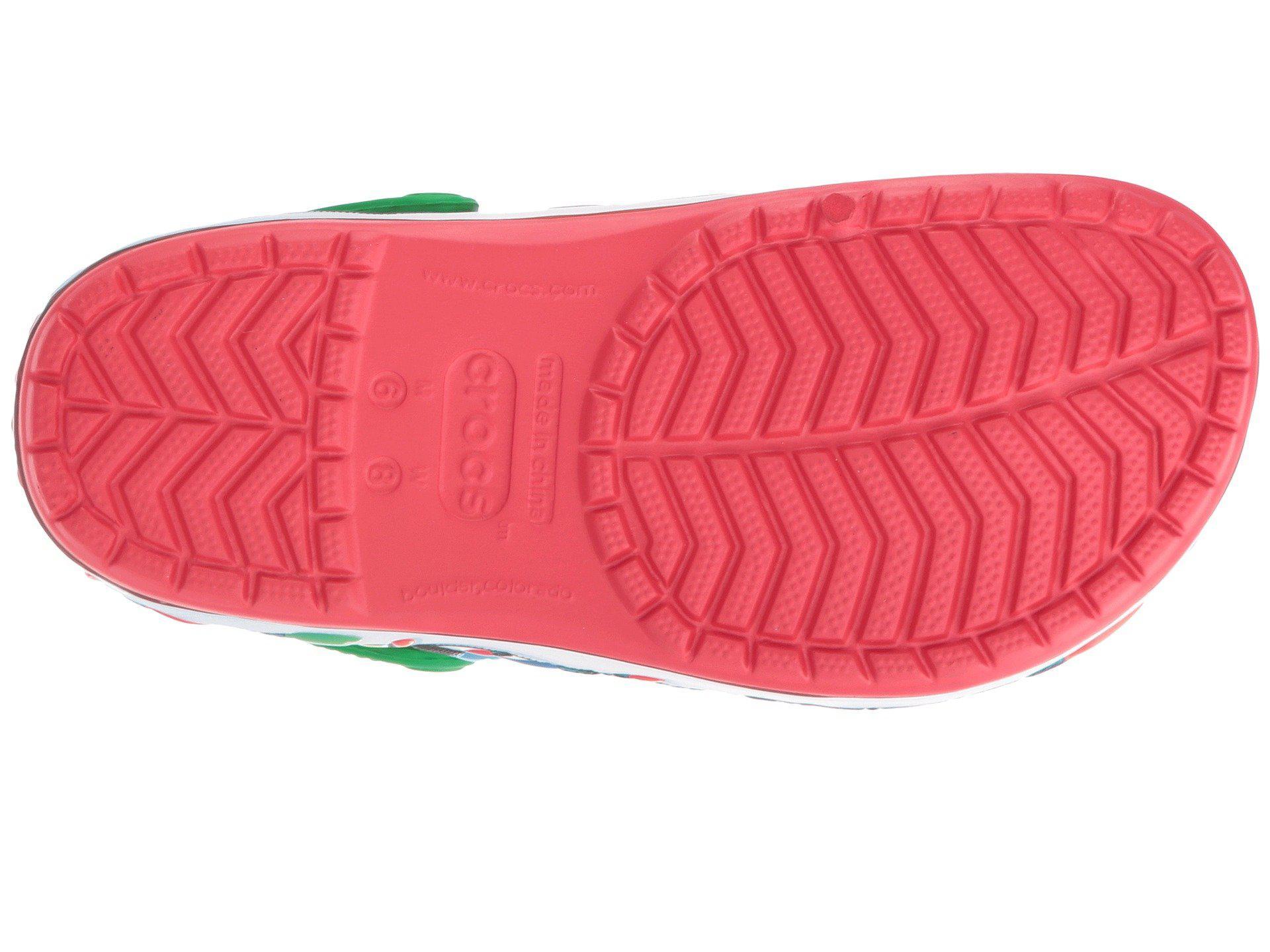 4fcc21b09dc06 Lyst - Crocs™ Crocband Holiday Lights Clog