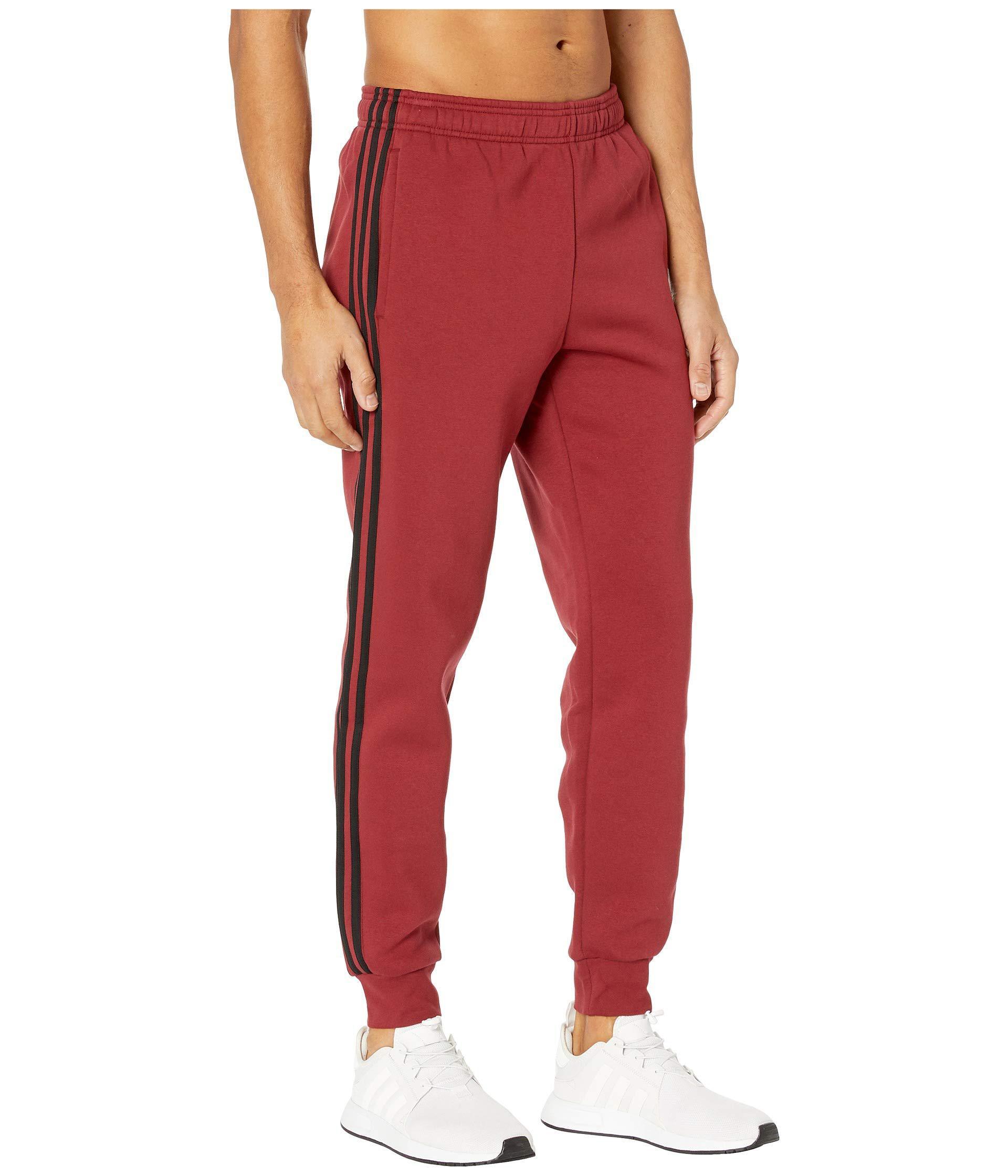 27d7a292eff9 Adidas - Red Essentials 3-stripes Jogger Pants for Men - Lyst. View  fullscreen