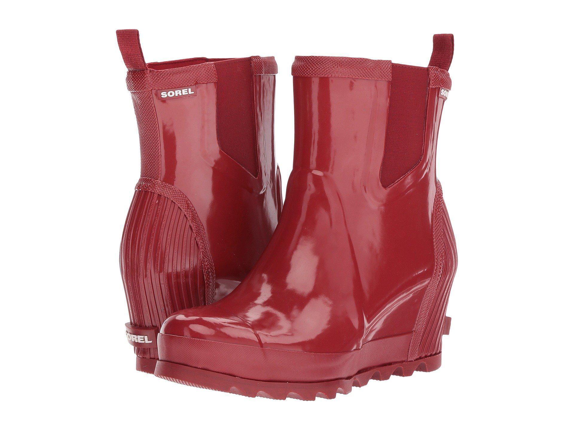 6cf69ea896e7 Lyst - Sorel Joan Rain Wedge Chelsea Gloss in Red