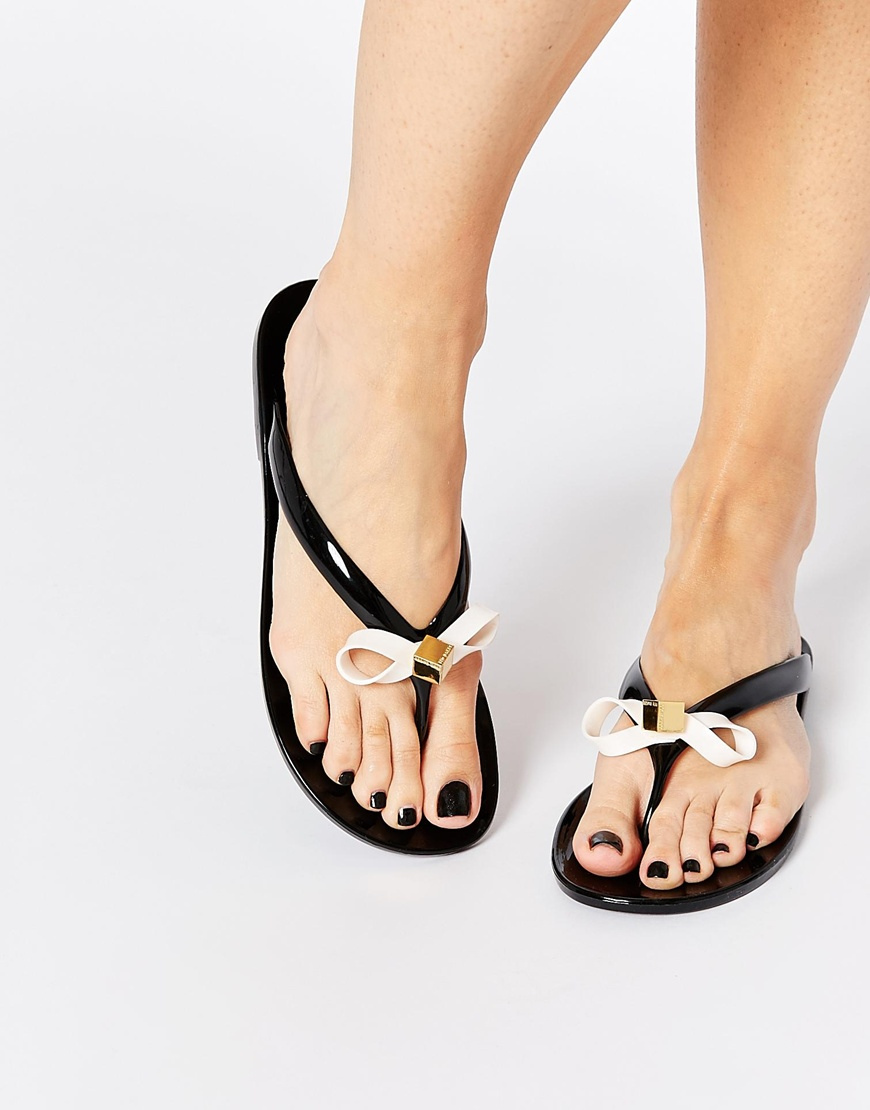 1ff0b255f82d Lyst - Ted Baker Taito Black Jelly Bow Flip Flops in Black