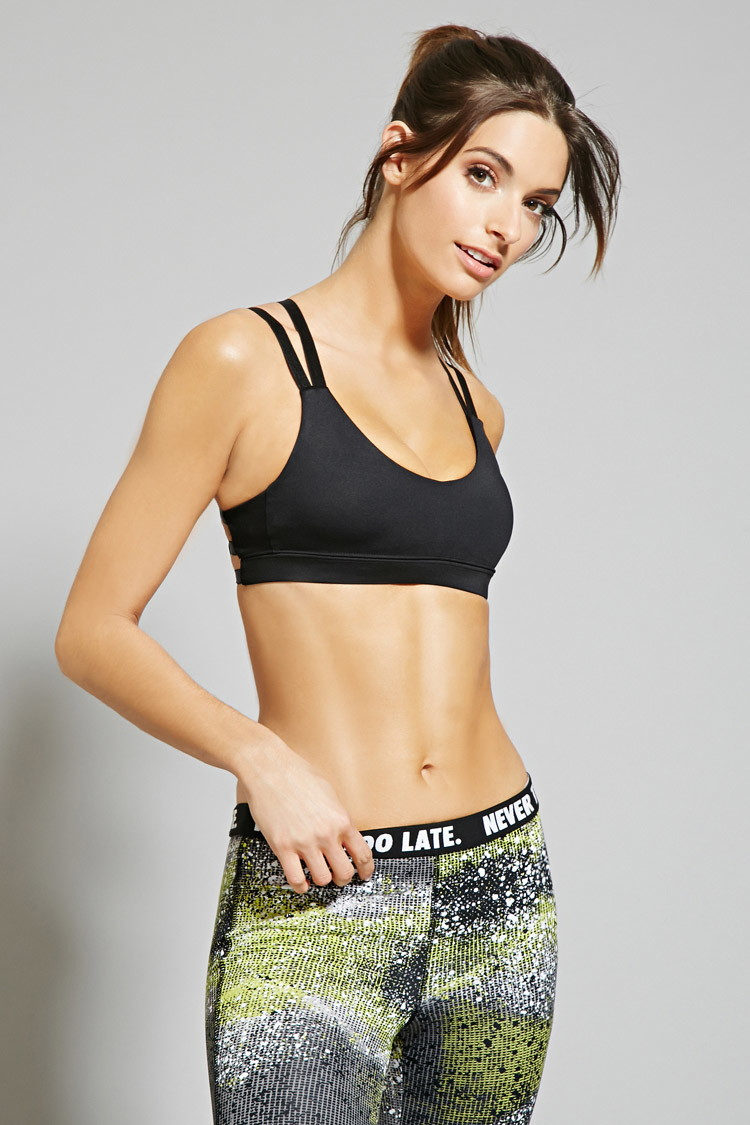 """0c69e65154fc2 Lyst - Forever 21 Low Impact €"""" Strappy Sports Bra in Black"""