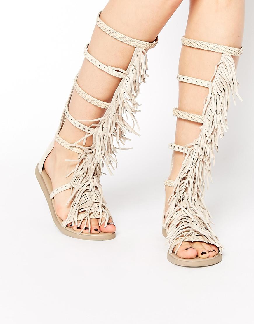 84d6b331141 Lyst - ALDO Tharesa Leather Fringe Gladiator Knee Flat Sandals in ...
