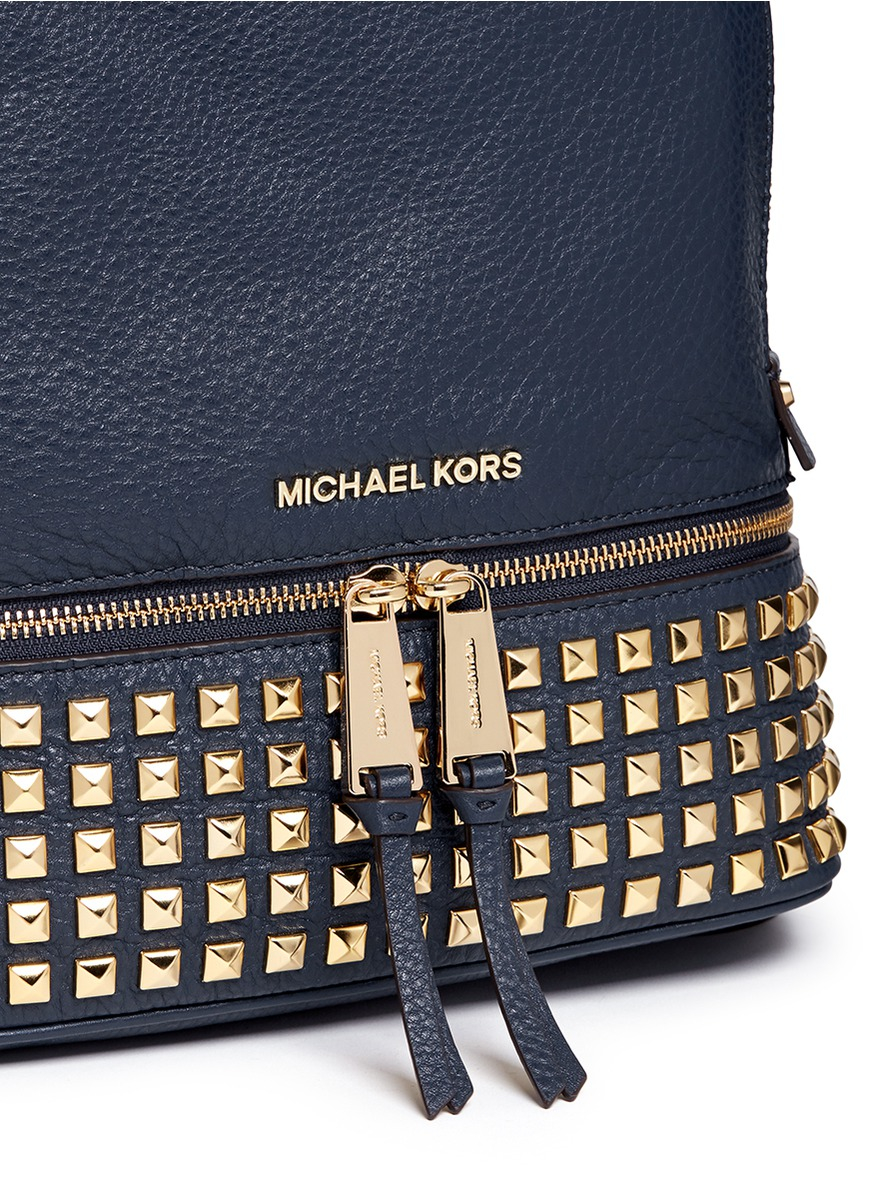 7b4f0189a3883 ... australia michael kors rhea small stud leather backpack in blue lyst  866a9 e8545