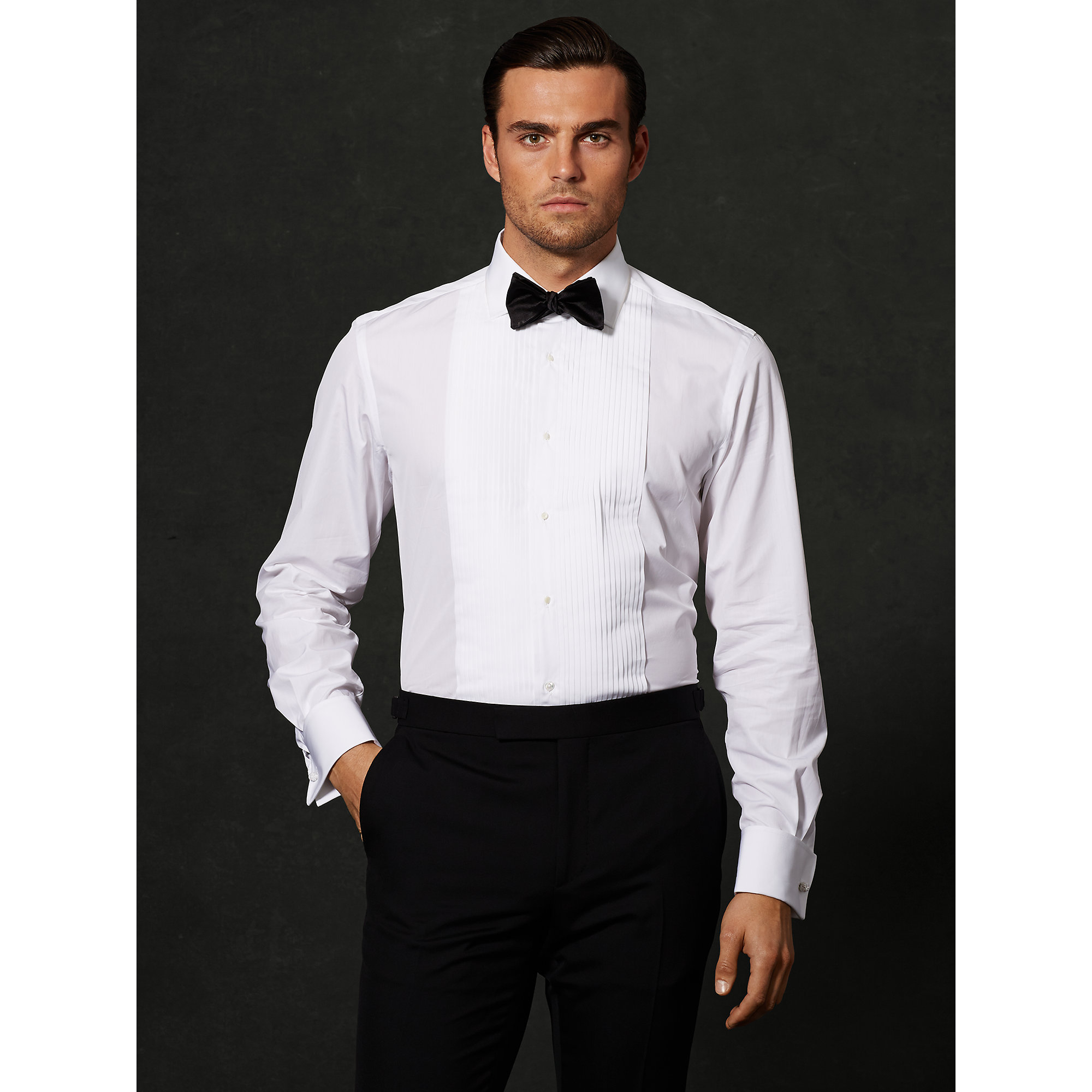 This fine tuxedo is ideal for those who prefer a slimmer cut. This Tailored Fit suit is wrinkle, water, and stain resistant. Woven in natural stretch wool for refined comfort. Satin lapel, covered button, and details. Single breasted notch lapel with single-button closure. Quarter-top pockets. Comfort-range waistband with self-adjusting stretch for ease.