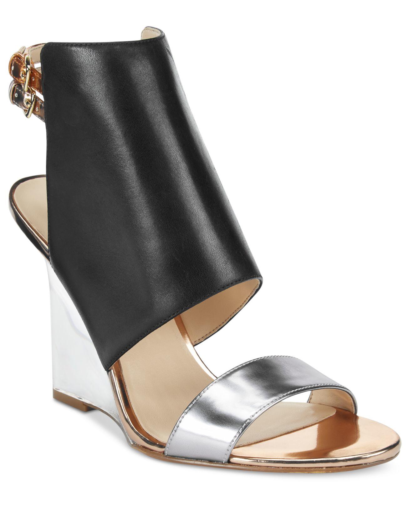 b8cac13ffe76 Lyst - Nine West Bueta Wedge Sandals in Black