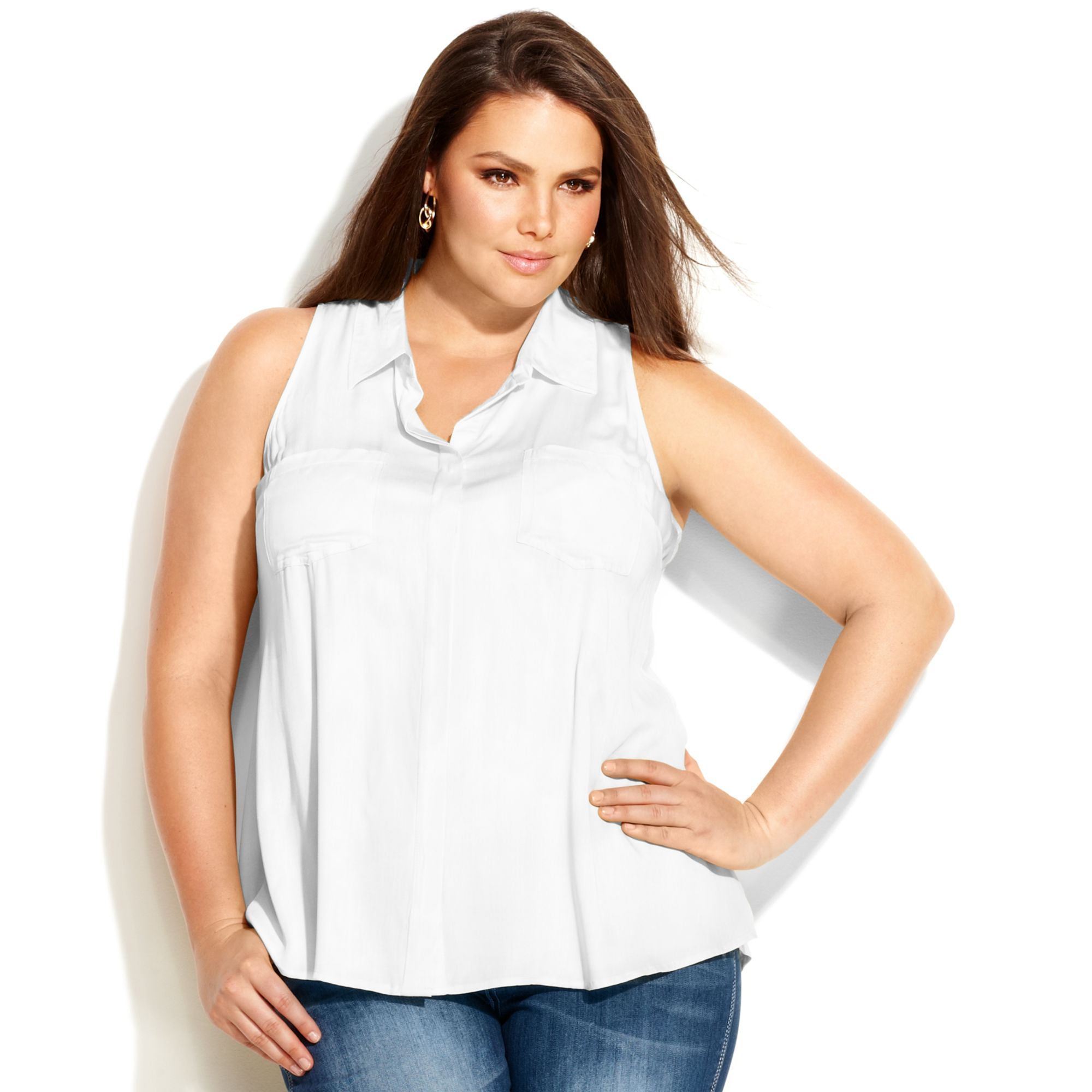 Plus Size Tops Explore a wide selection of designer plus size tops. You'll find a range of colors to match any mood, and unique blouses that combine bold patterns and eye-catching details.