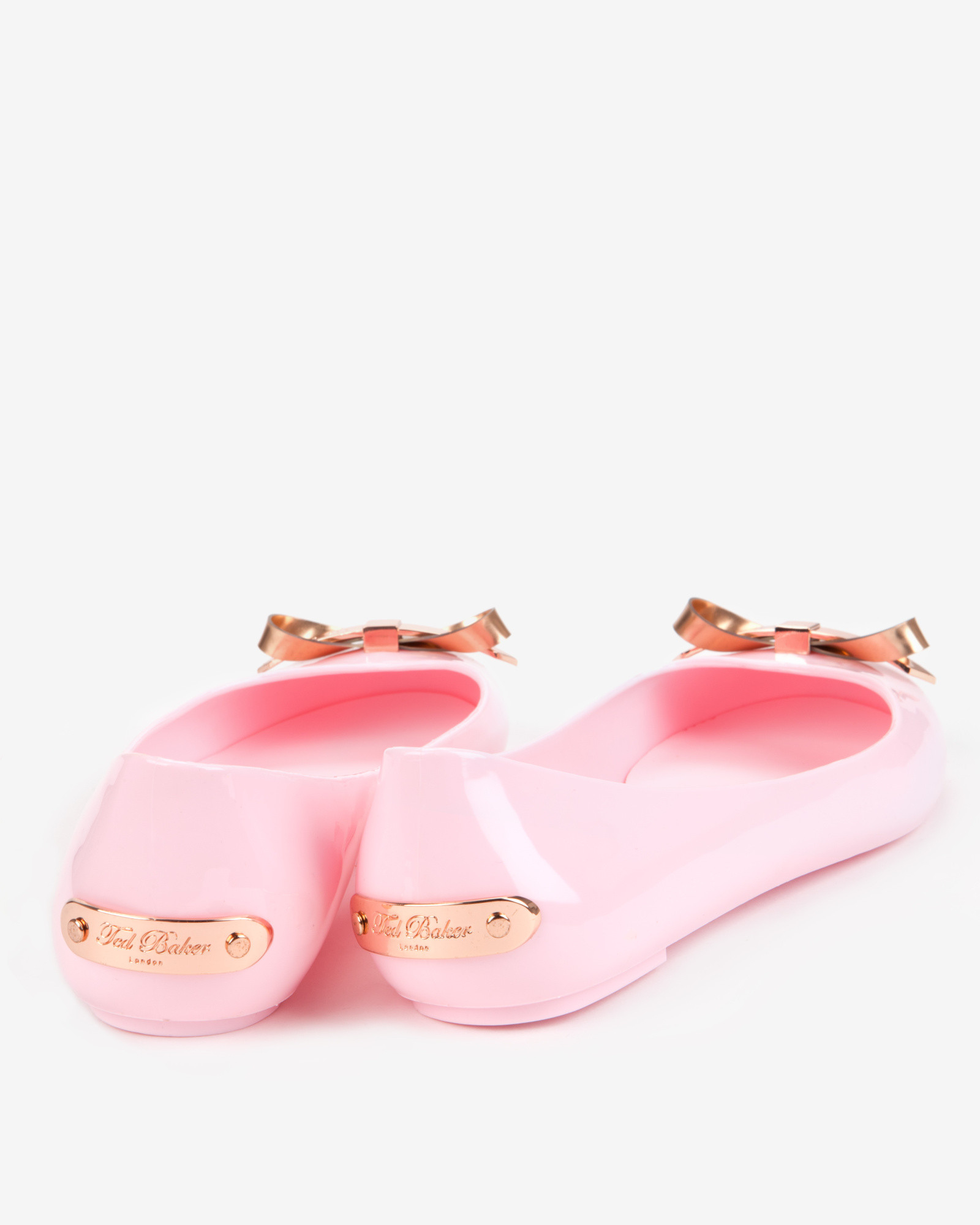 a89f959b415fa Lyst - Ted Baker Slim Bow Jelly Pumps in Pink