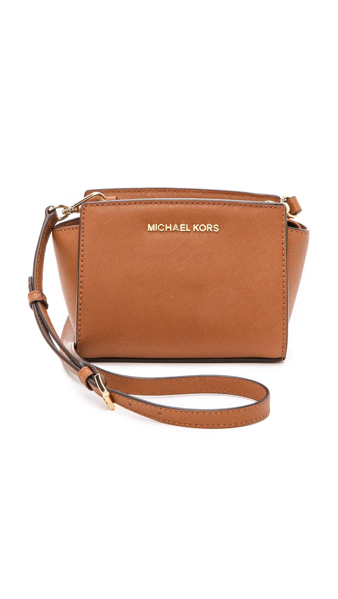 2c55513cbf6860 ... low price lyst michael michael kors selma mini messenger bag luggage in  brown b8de3 0d498