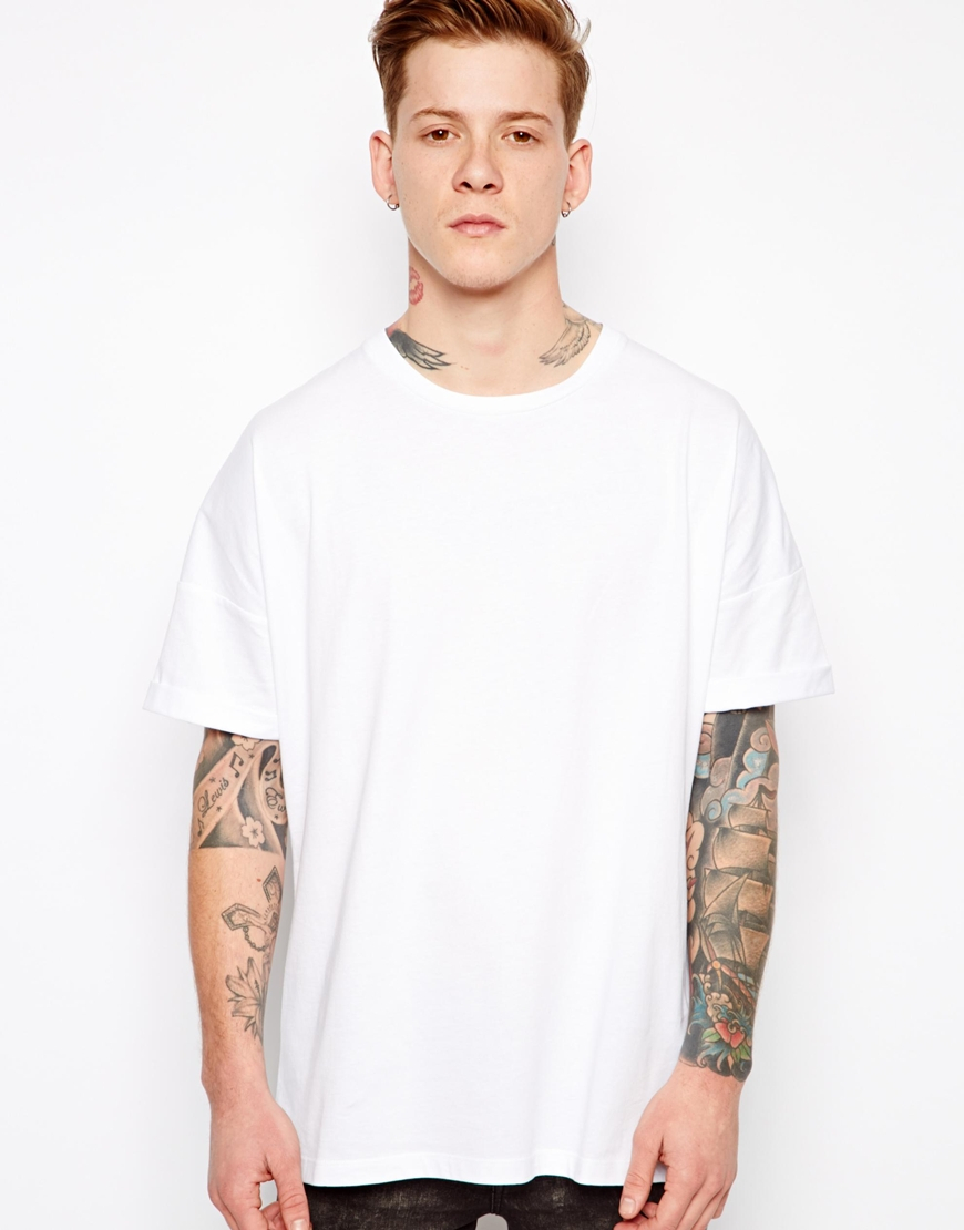 asos white t shirt with oversized fit and roll sleeve for men lyst. Black Bedroom Furniture Sets. Home Design Ideas