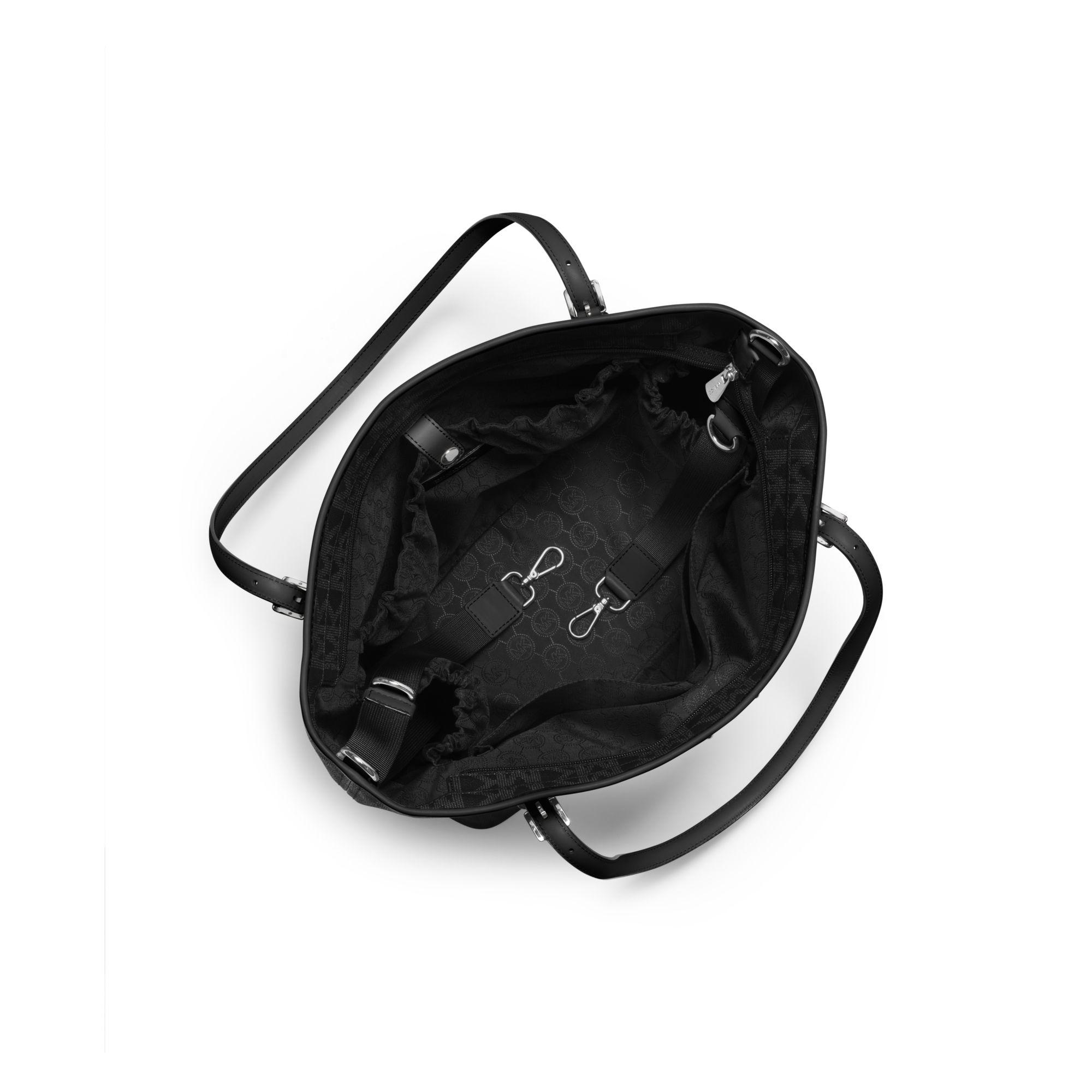 michael kors jet set travel logo diaper bag in black lyst. Black Bedroom Furniture Sets. Home Design Ideas