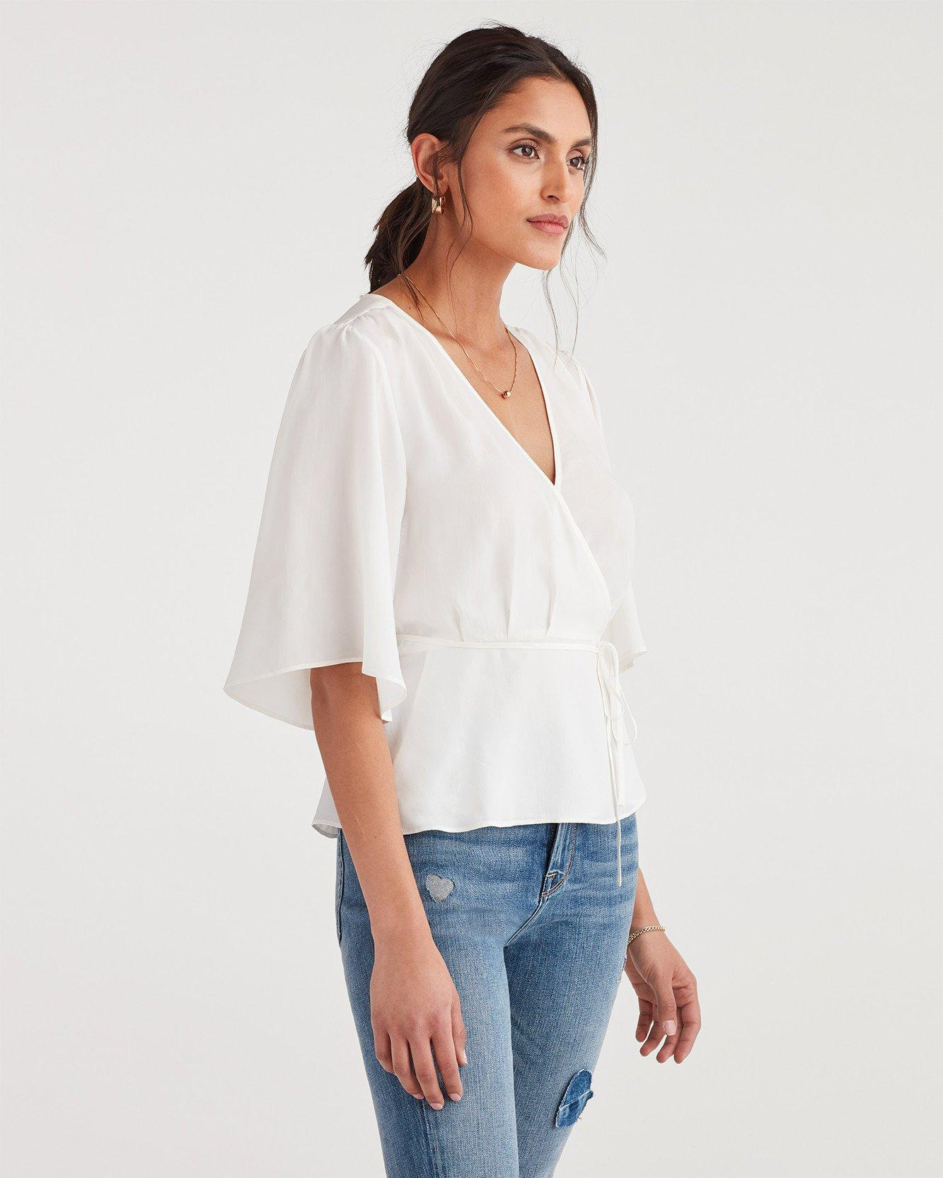 e29183e18ec 7 For All Mankind Wrap Front Short Sleeve Top in White - Lyst