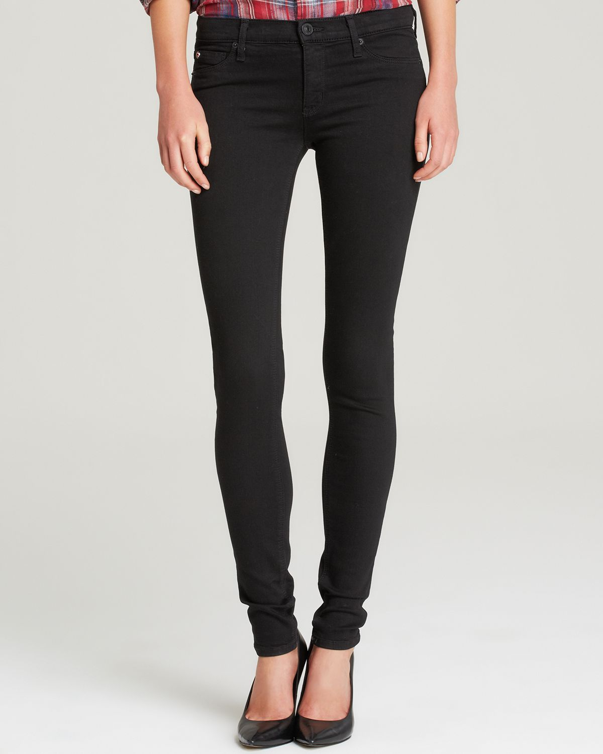 The Twiggy cut from Joe's Jeans boasts an ultra-slim stretch fit and extra-long inseam that put all eyes on you in a streamlined, jet-black wash.