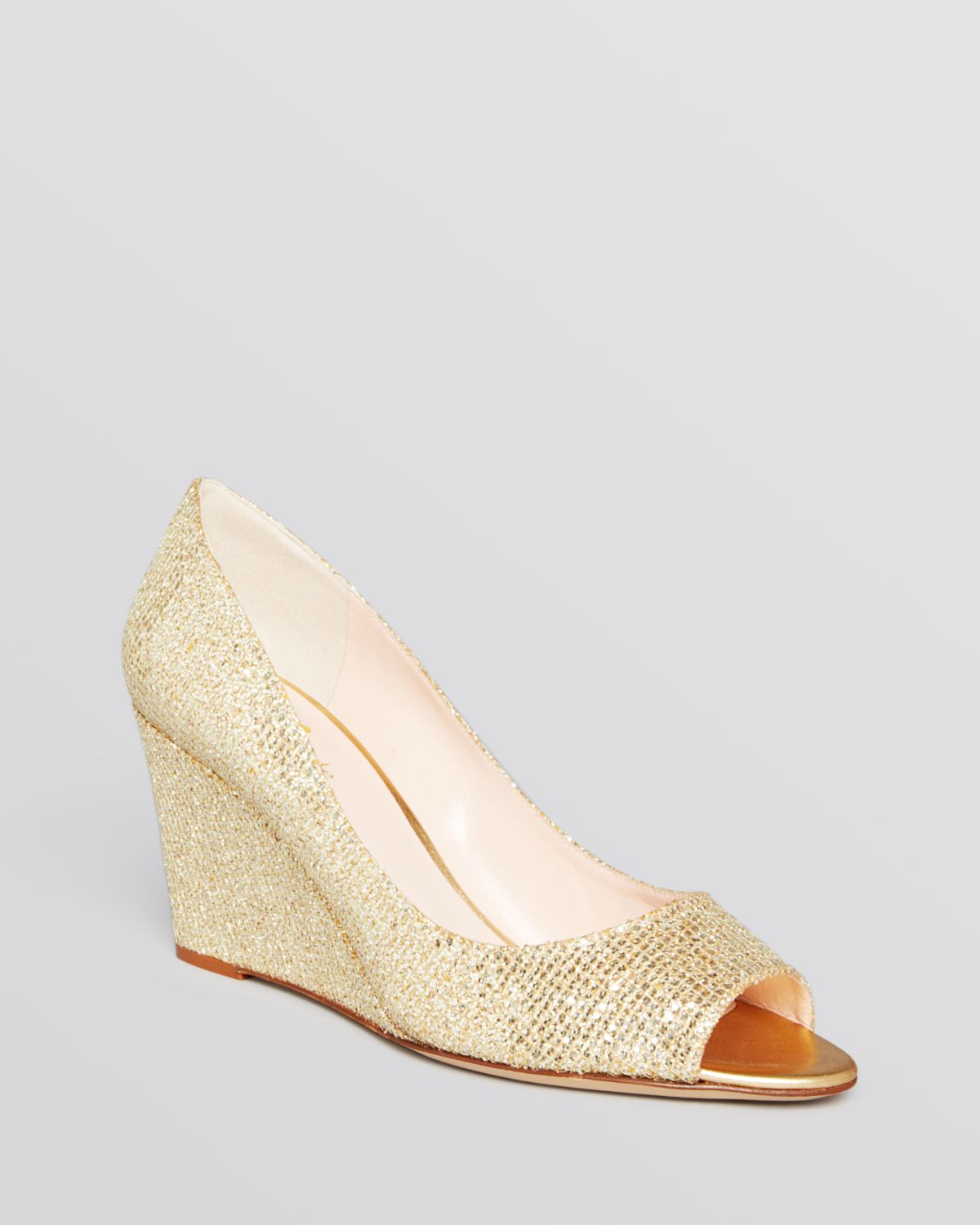 58002957e518 Lyst - Kate Spade Peep Toe Wedge Evening Pumps - Radiant Gold in ...