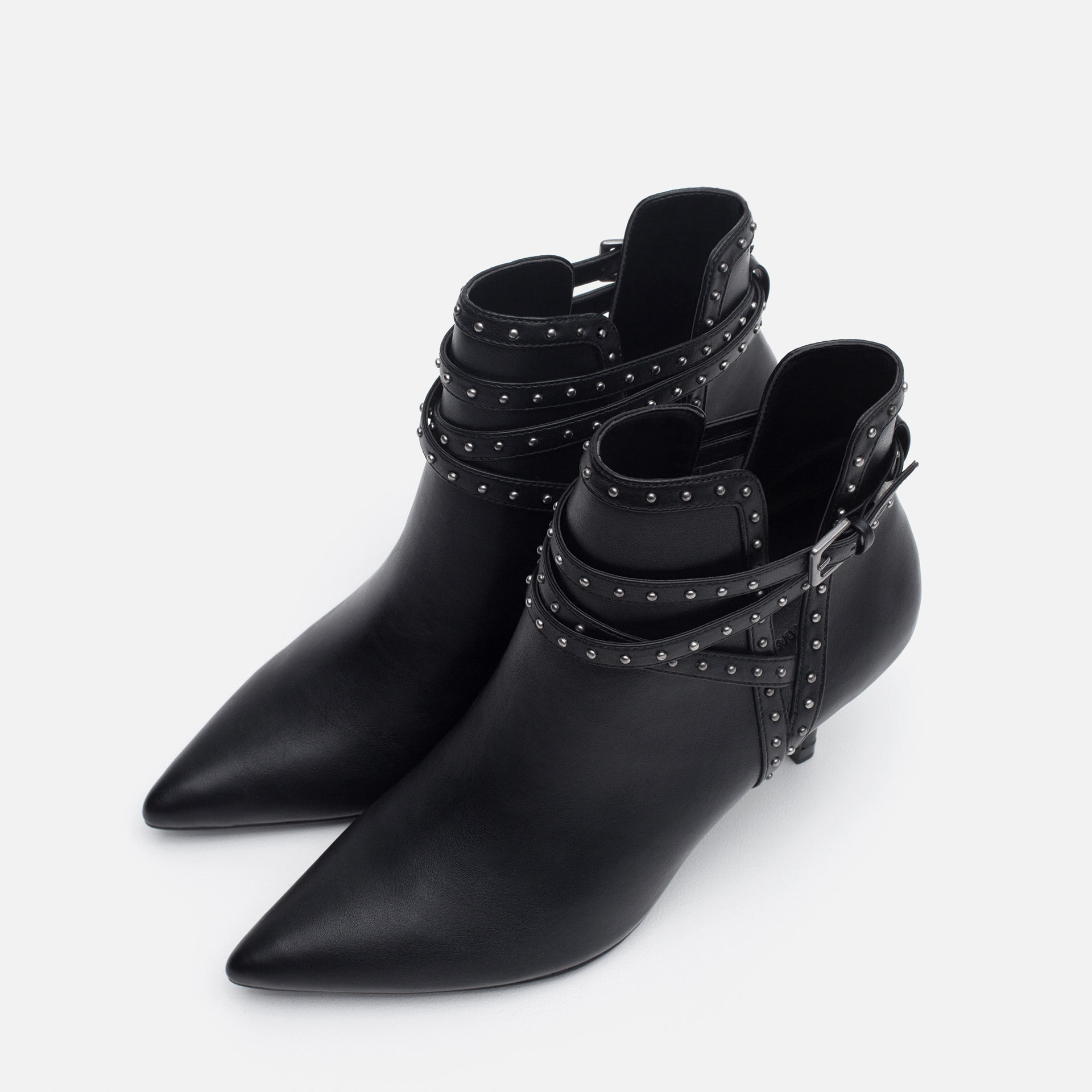 More Details Alexander Wang Kori Leather Lift-Heel Ankle Boot, Black Details Alexander Wang leather ankle boot. Pointed toe. Pull-tab on backstay for ease of dress. Covered stretch insets at sides. Tilt-effect heel with rose golden plate detail.