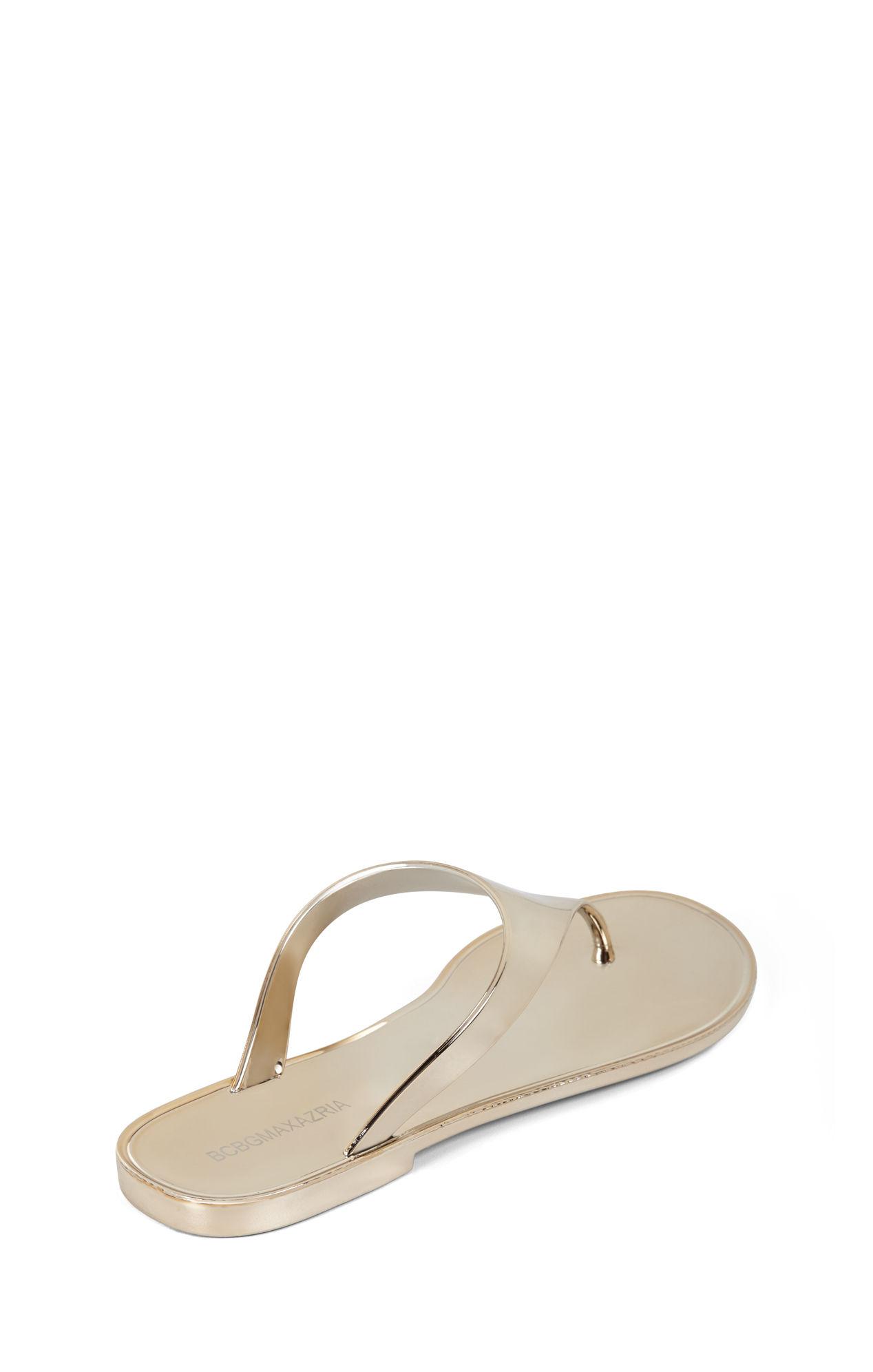 8a0427c06f7b Lyst bcbgmaxazria sabba metallic thong sandal in metallic jpg 1268x1992 Bcbg  gold sandals