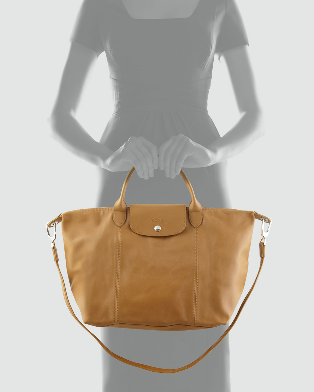 ba86c2a48b2f Lyst - Longchamp Le Pliage Cuir Handbag with Strap in Natural