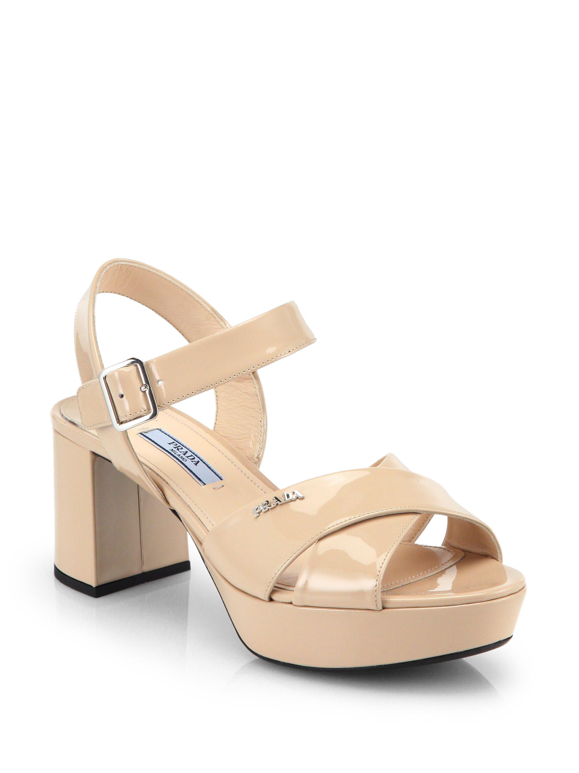 d5cc235eed8 Lyst - Prada Patent Leather Crisscross Platform Sandals in Natural