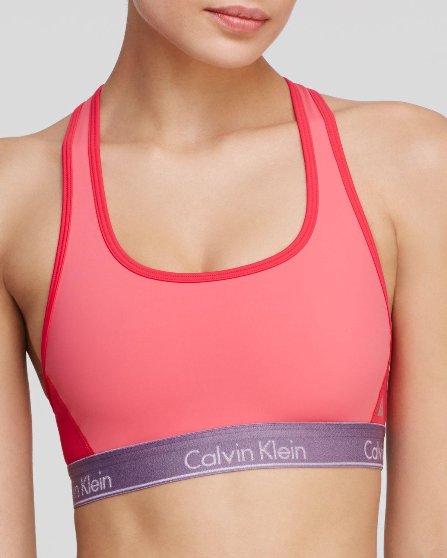1369be4d9e Lyst - Calvin Klein Sports Bra - Flex Motion Racerback Medium Impact ...