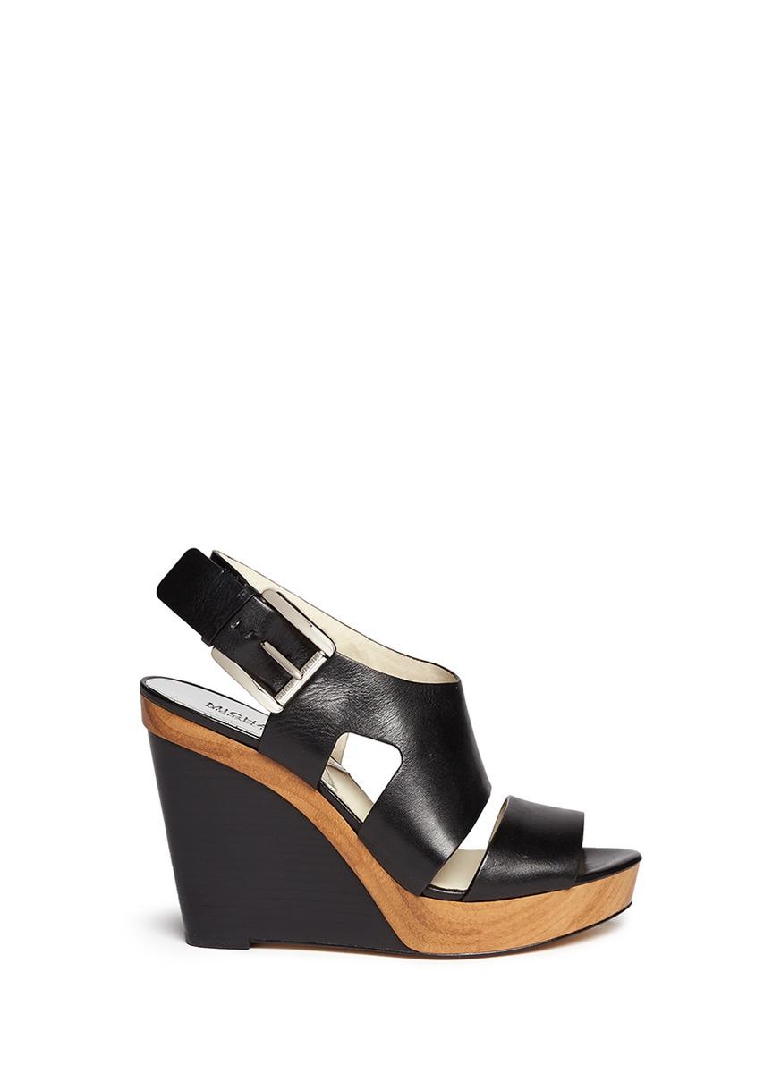 29d84a8a0d5 Lyst - MICHAEL Michael Kors  Carla  Leather Platform Wedge Sandals ...