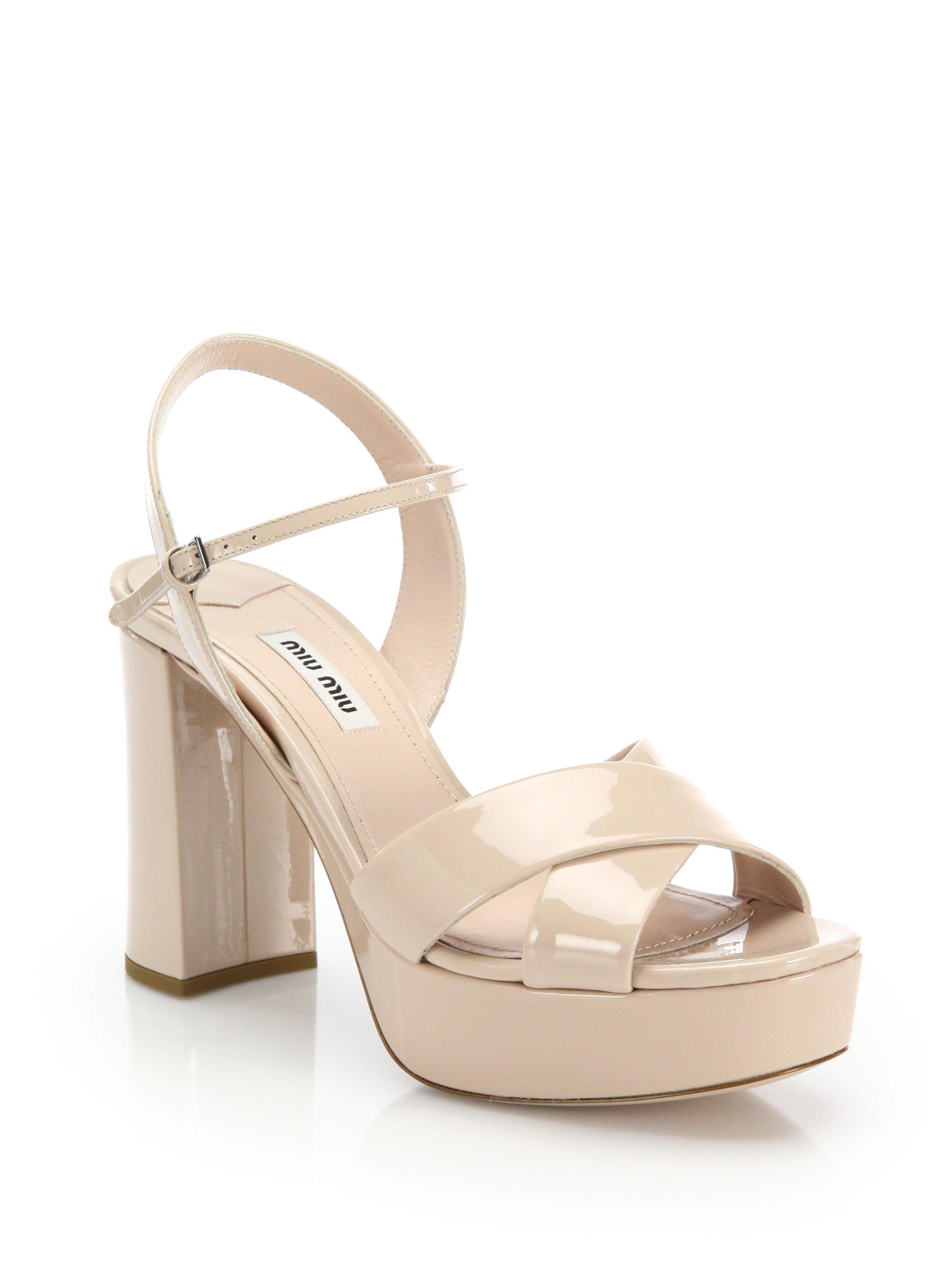 68610d8bd94 Lyst - Miu Miu Crisscross Patent Platform Sandals in Natural