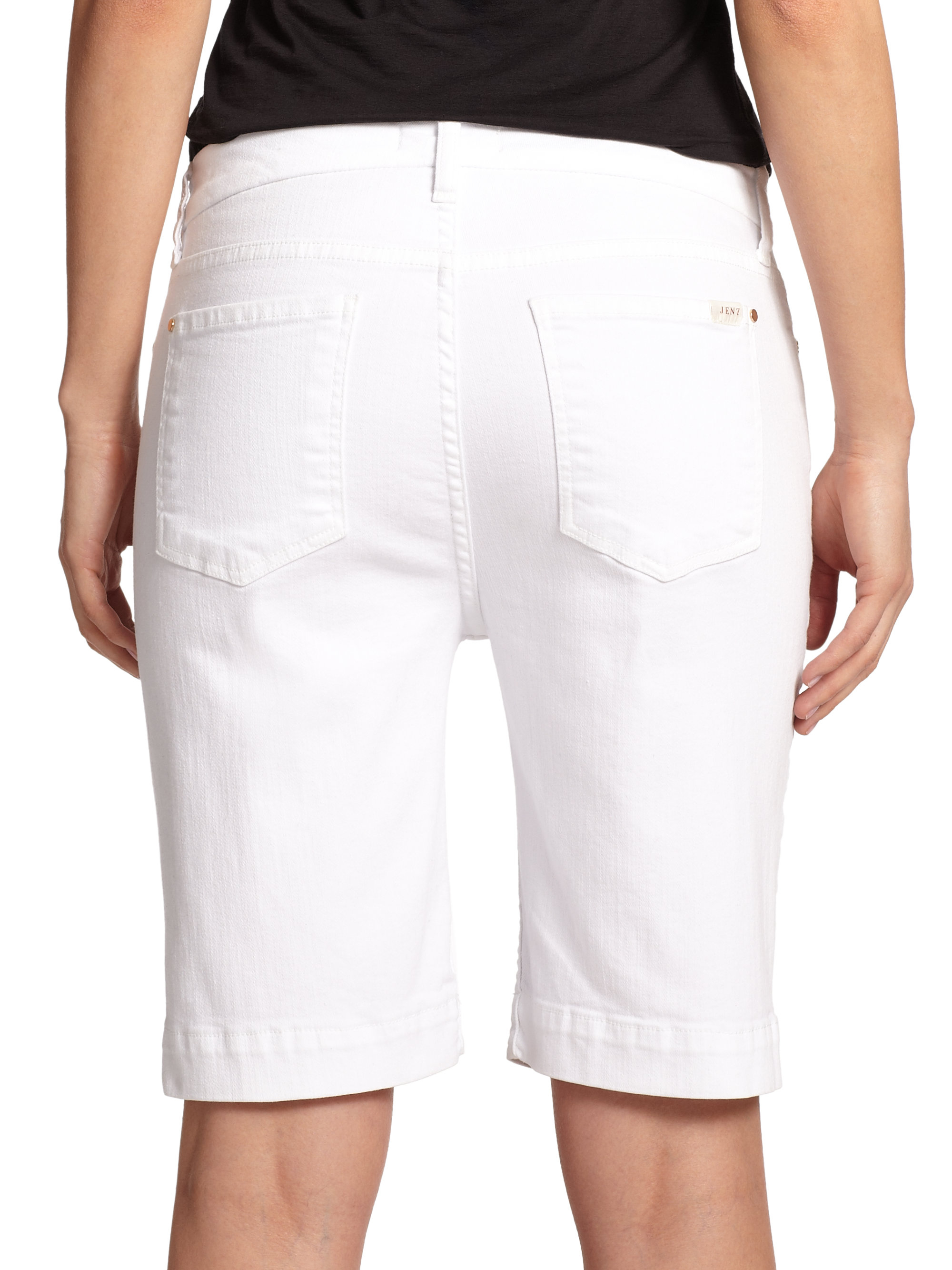 These high-waisted Bermuda shorts are made of a soft cotton denim with just the right amount of stretch and feature rips and shreds down the thighs and frayed hems.