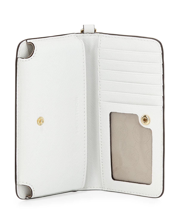 2c5370ff4c44 MICHAEL Michael Kors Jet Set Travel Slim Tech Wristlet in White - Lyst