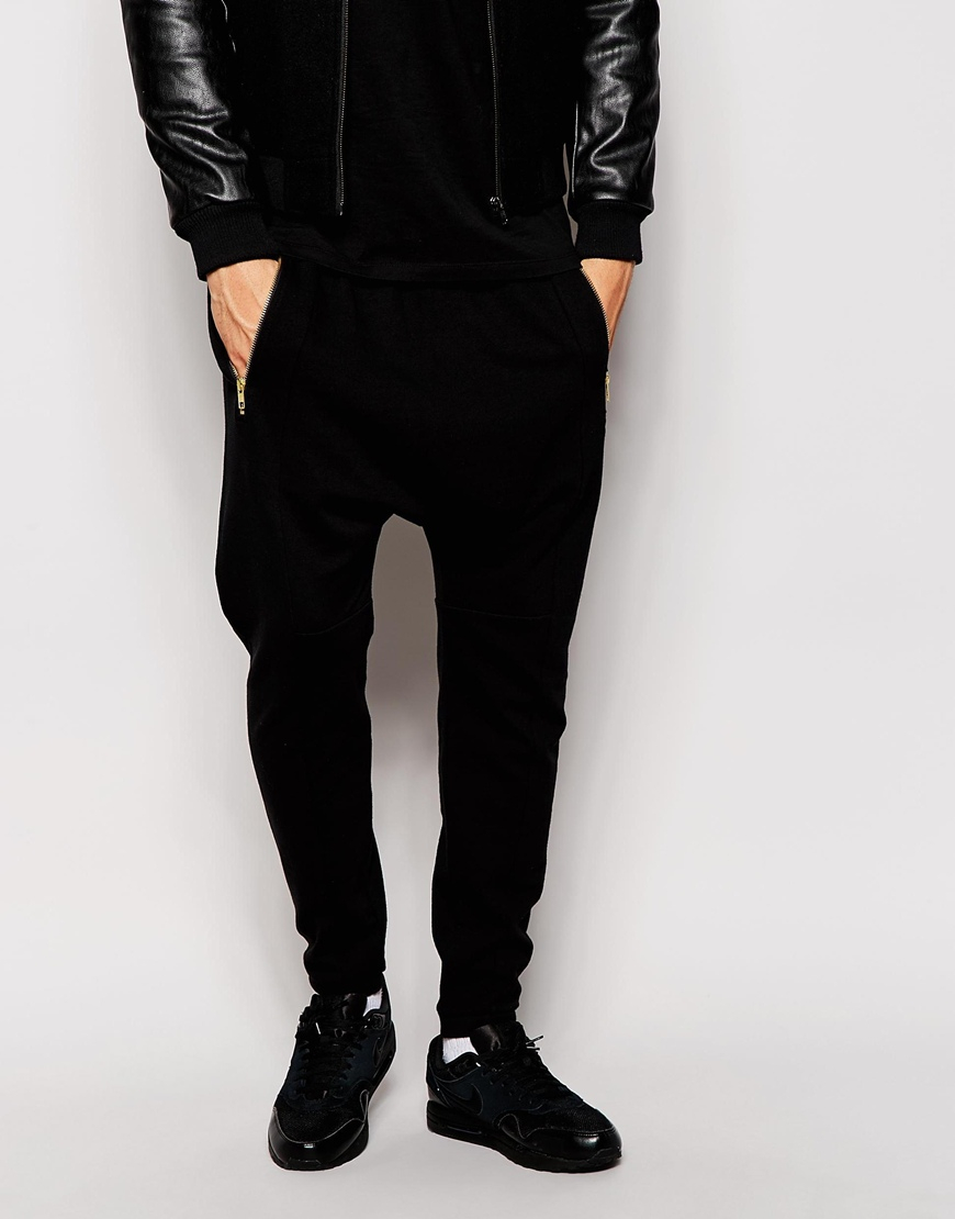 Fit: Drop crotch Relax Knit wool sarouel-style lounge jogger in black Dropped inseam Drawstring at elasticized poplin waistband YKK font zipper pocket Velcro Flap back pocket Button-fly Tonal stitching Machine wash cold.
