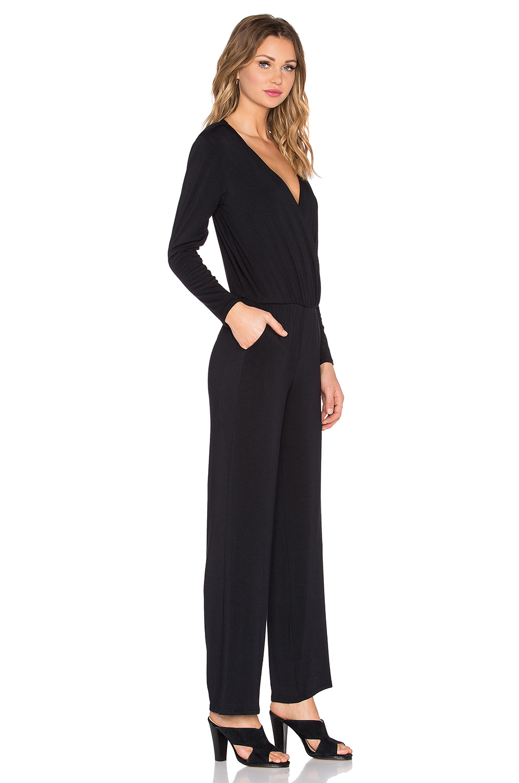 e3b8e591ef3 Lyst - Michael Stars Dana Long Sleeve Surplice Jumpsuit in Black