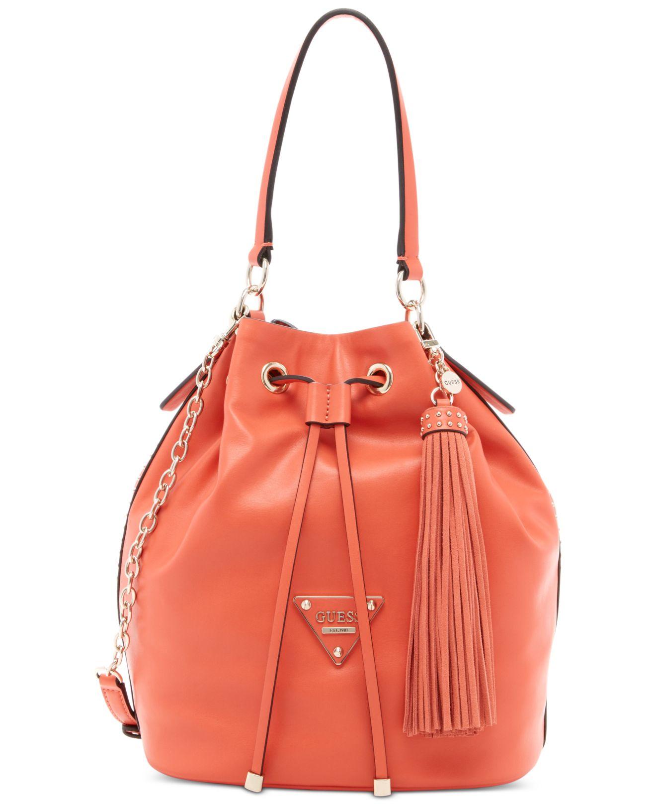 b783a36613f Lyst - Guess Thompson Drawstring Bucket Bag in Orange