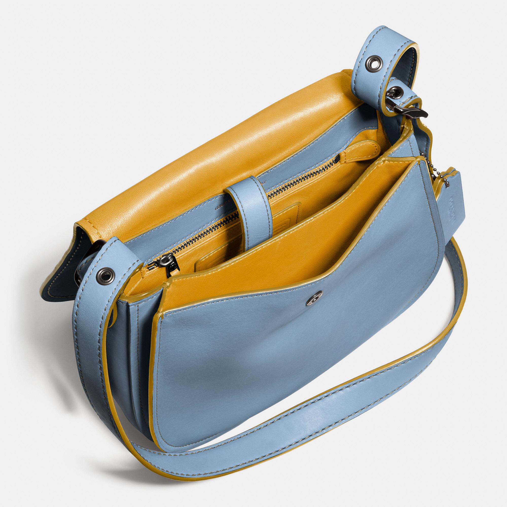 33268dea01c Lyst - COACH Saddle Bag 23 In Glovetanned Leather in Blue