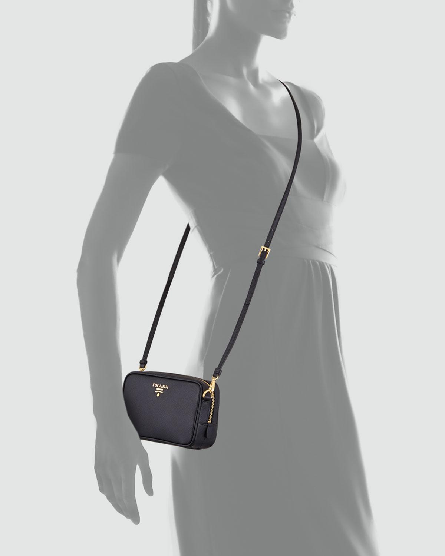 e815608403dd ... italy prada saffiano mini zip crossbody bag in black lyst d2e90 c4652