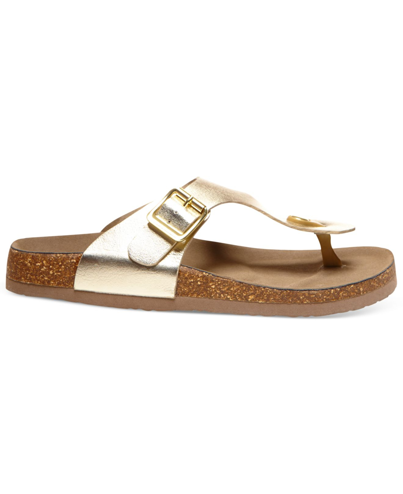 3030e1c1c068 Lyst - Madden Girl Boise Footbed Thong Sandals in Metallic