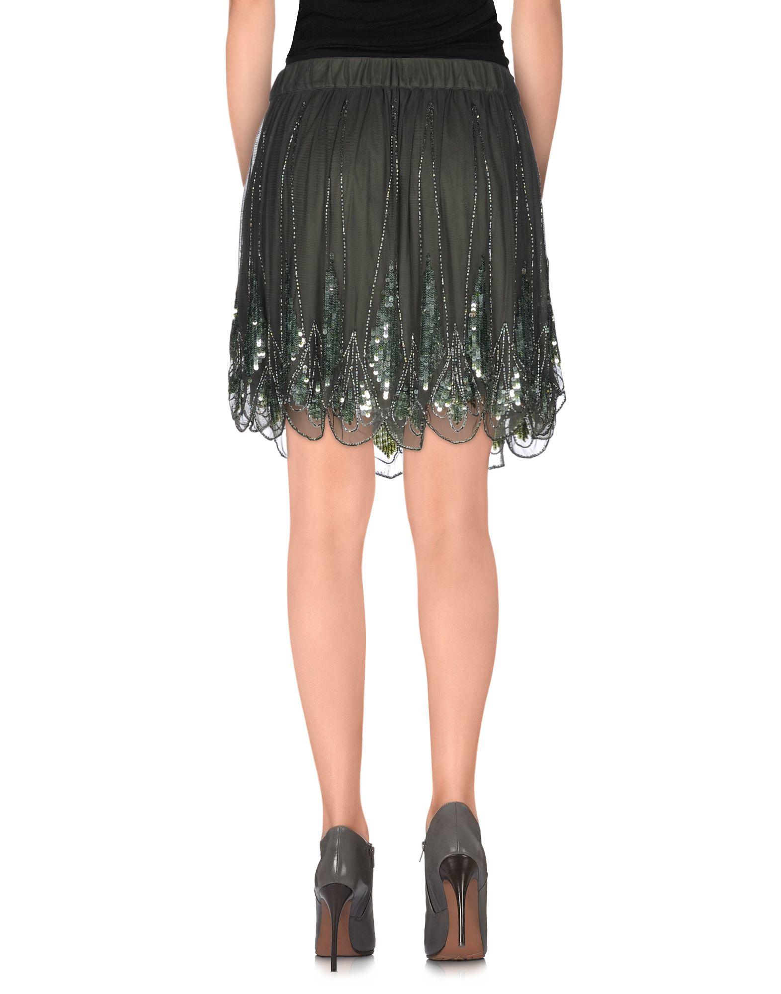 manila grace mini skirt in green lyst