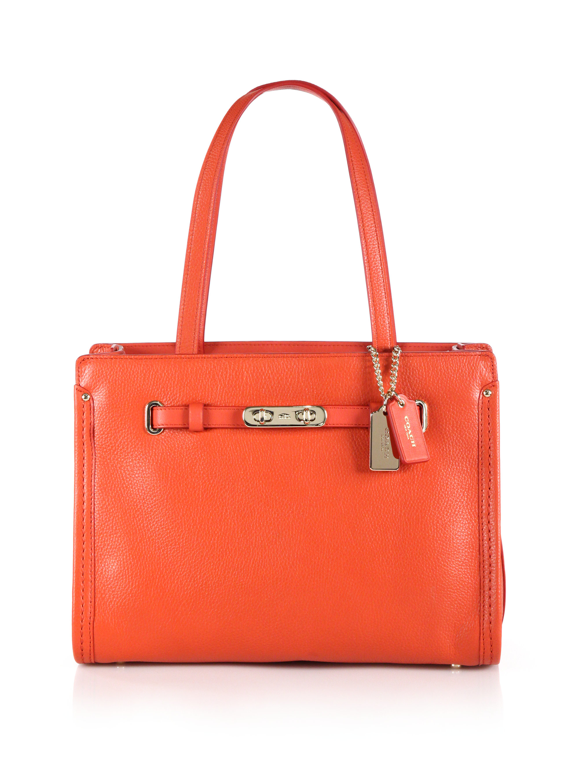 eb2cb71bd27a Lyst - COACH Swagger Small Leather Tote in Orange