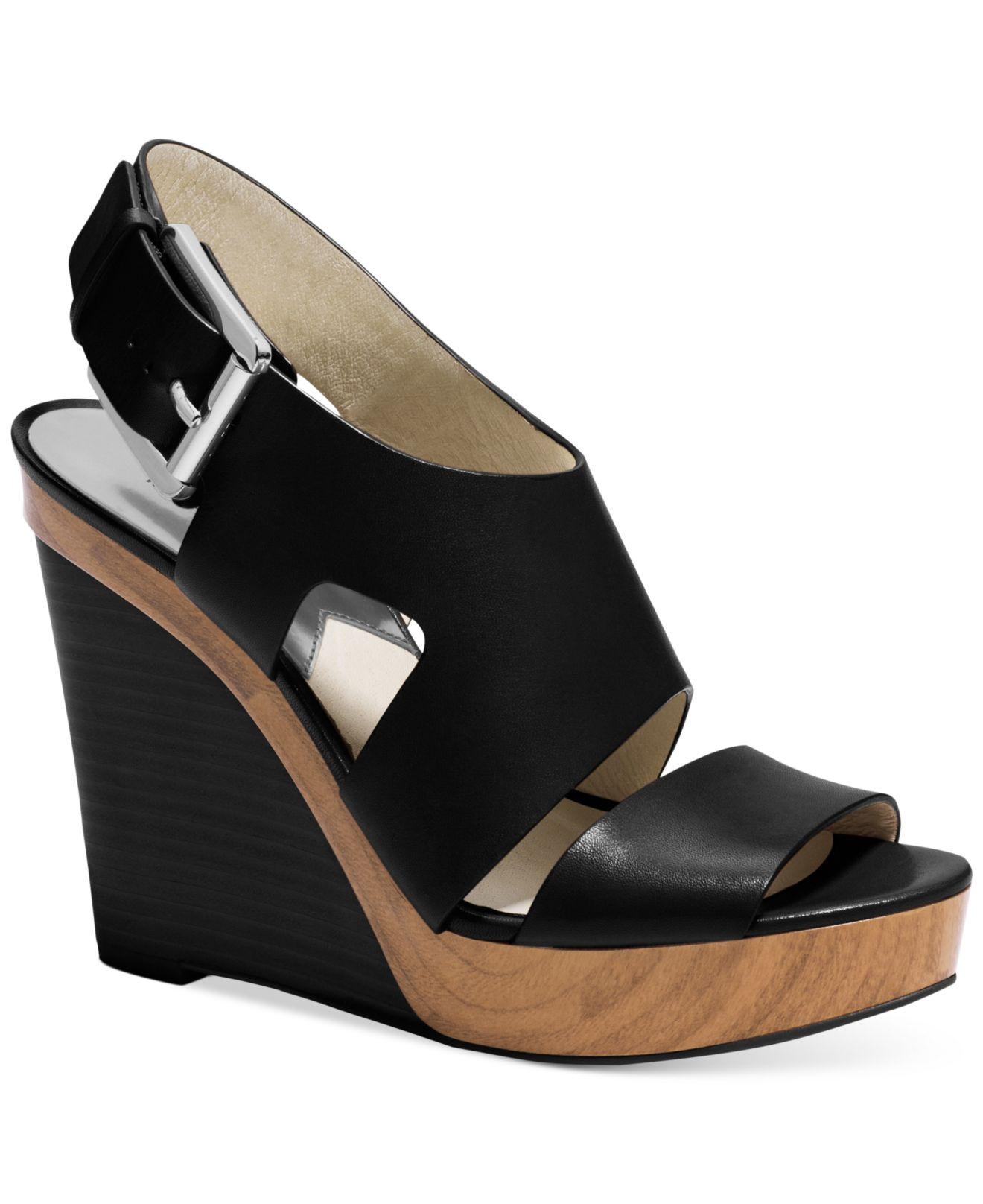 1b9dc07a4f8 Lyst - Michael Kors Michael Carla Platform Wedge Sandals in Black