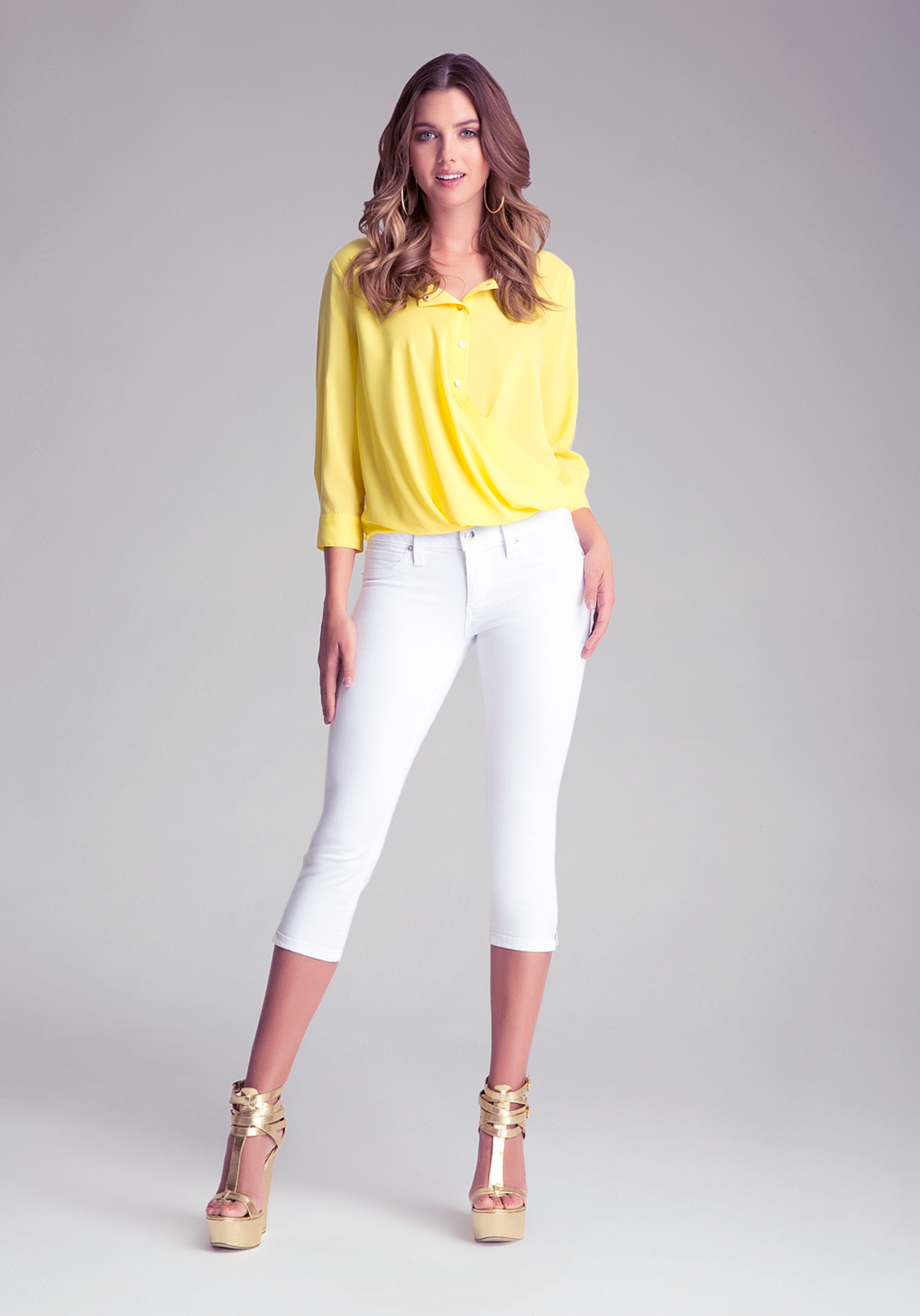 Bebe Side Slit Capri Jeans in White | Lyst