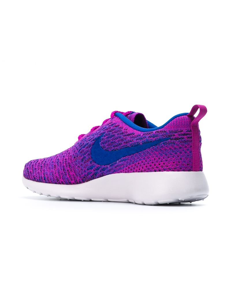 nike roshe run flyknit sneakers in pink lyst